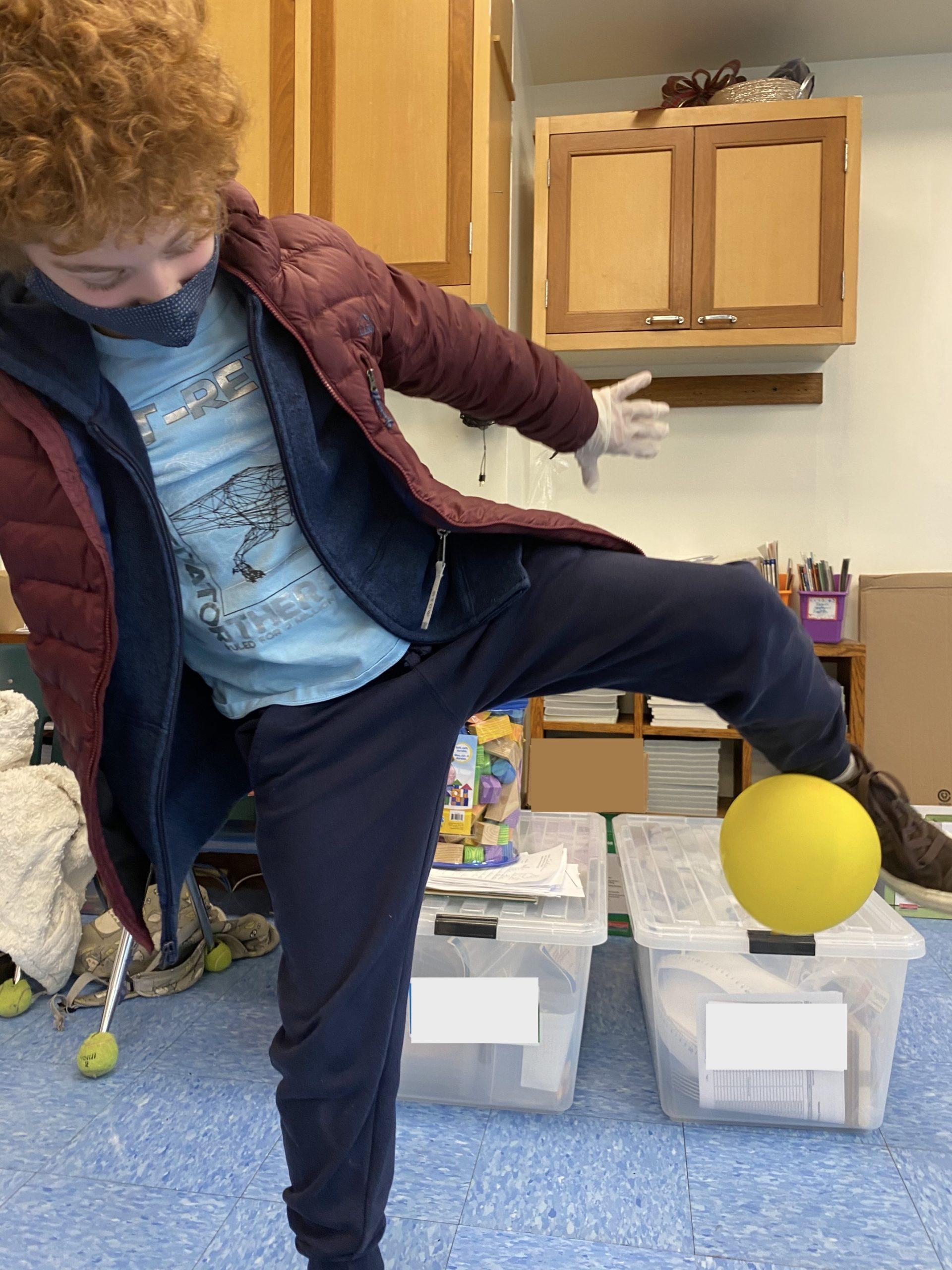 Bridgehampton School third grader Declan DeSouza demonstrates electric and magnetic forces.