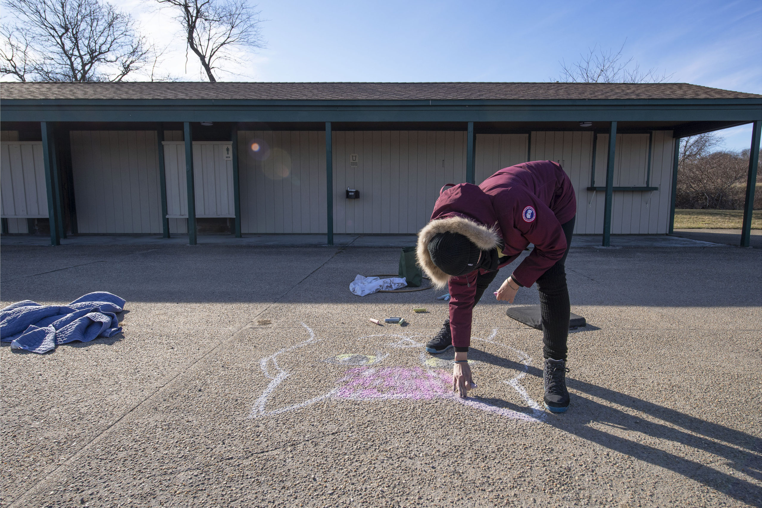 Becca Wilson drove from Hampton Bays to participate during a chalk-drawing get-together hosted by Kate Mueth and the Neo-Political Cowgirls at the Third House grounds in Montauk on Sunday.   MICHAEL HELLER