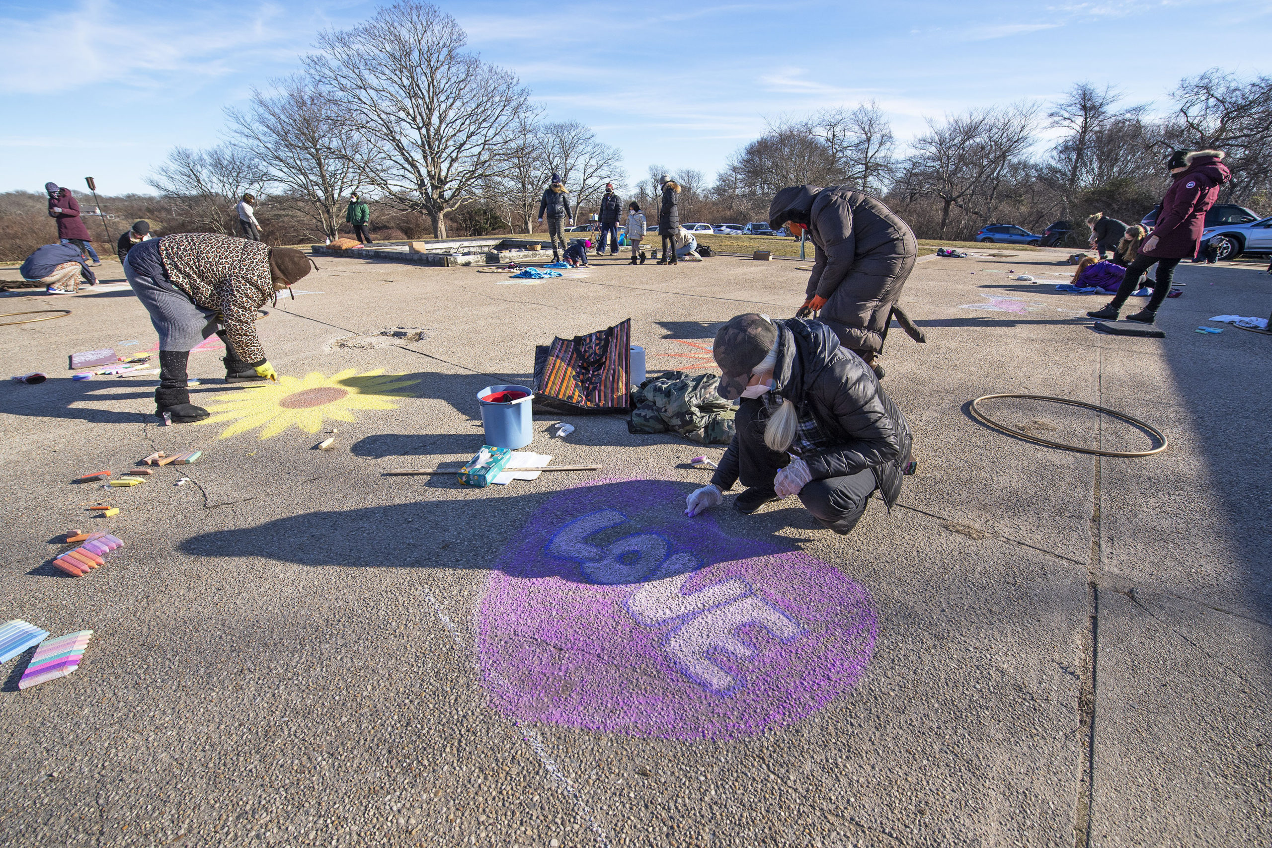Faith Henderson puts finishing touches on her art during a chalk-drawing get-together hosted by Kate Mueth and the Neo-Political Cowgirls at the Third House grounds in Montauk on Sunday.   MICHAEL HELLER