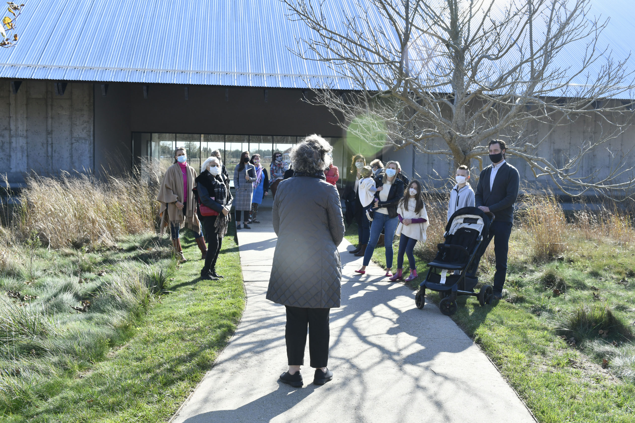 Parrish Art Museum curator Alicia Longwell takes Business Alliance members on a tour of