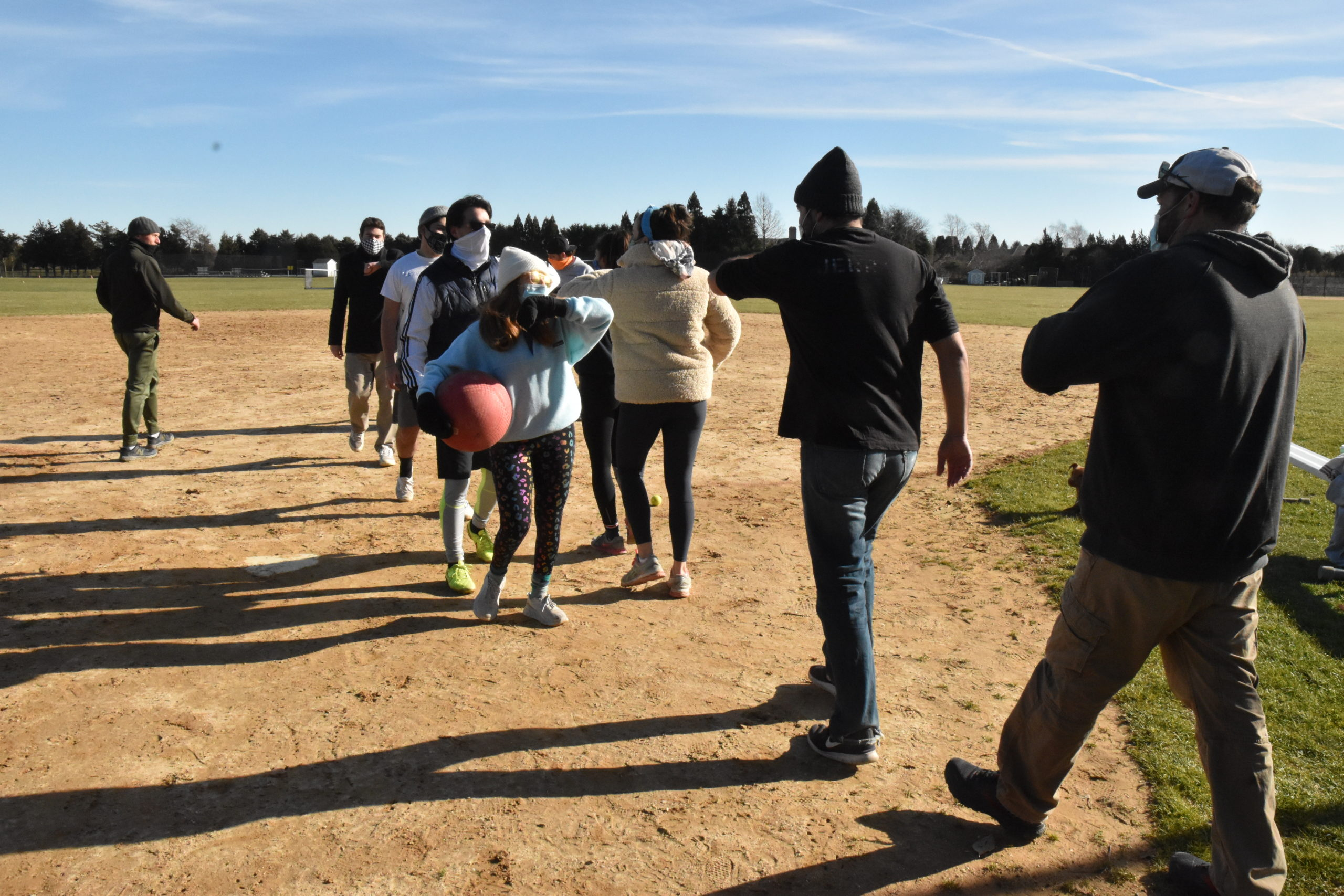 Instead of high-fives, it was elbow bumps after the Southampton Village team bested the Southampton Town team in a kickball game at Southampton Intermediate School on Sunday. STEPHEN J. KOTZ
