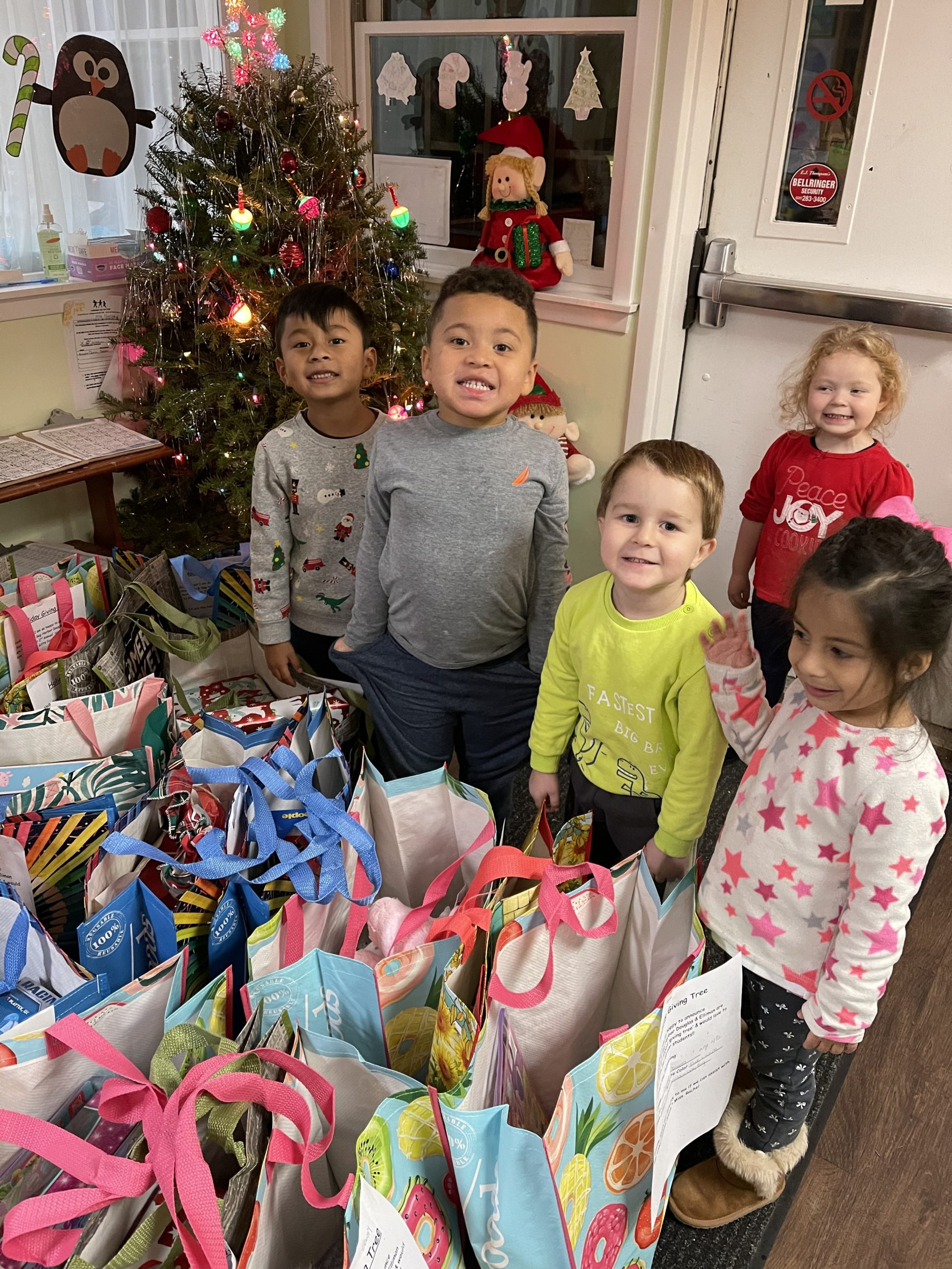 Children at the Southampton Day Care, a nonprofit day care center, receive gifts from a gift giving campaign organized by Brianna Ottati, a real estate agent at Douglas Elliman.