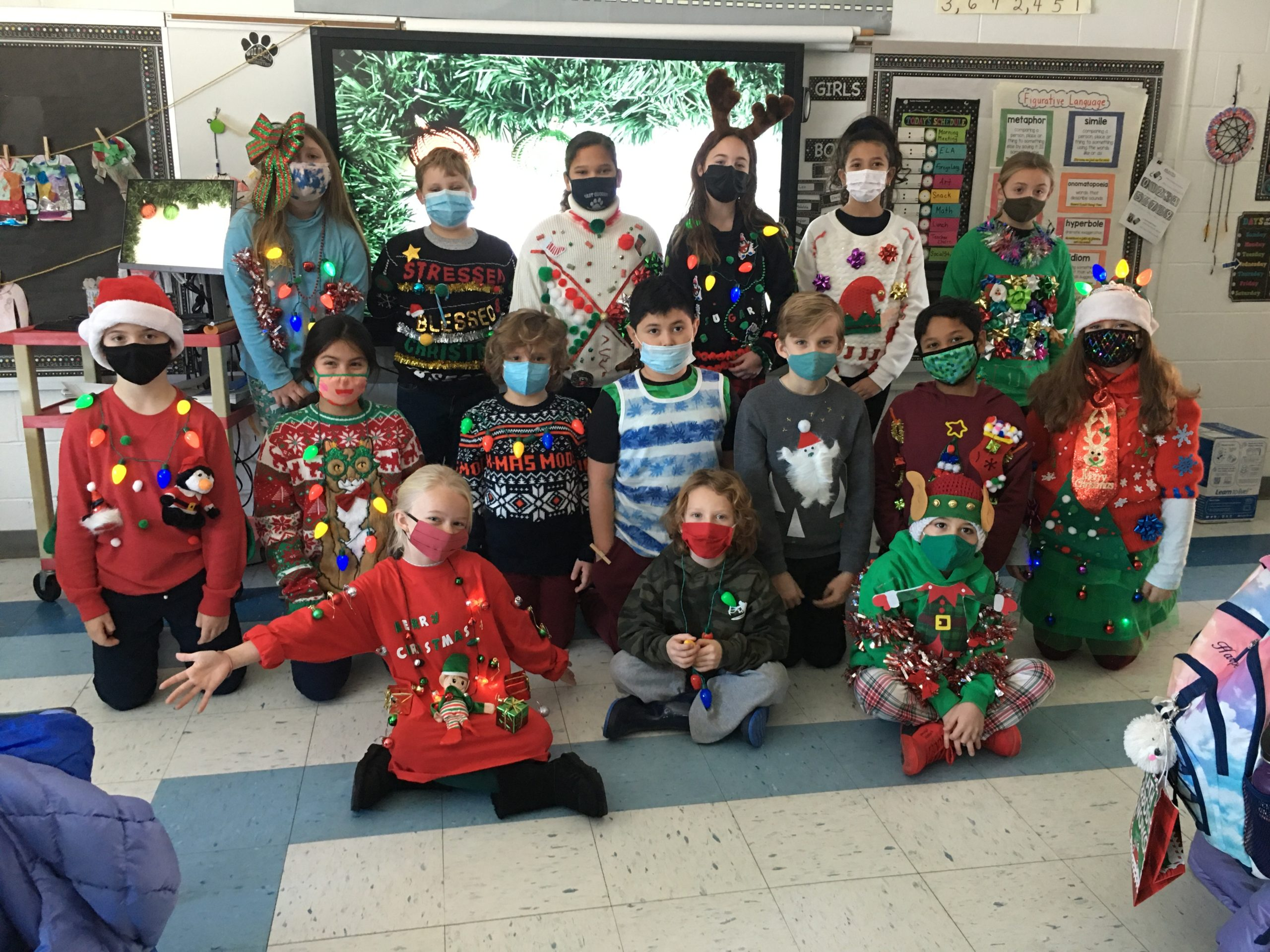 Students in Mrs. Eileen Variale's class at East Quogue Elementary School show off their ugly sweaters.