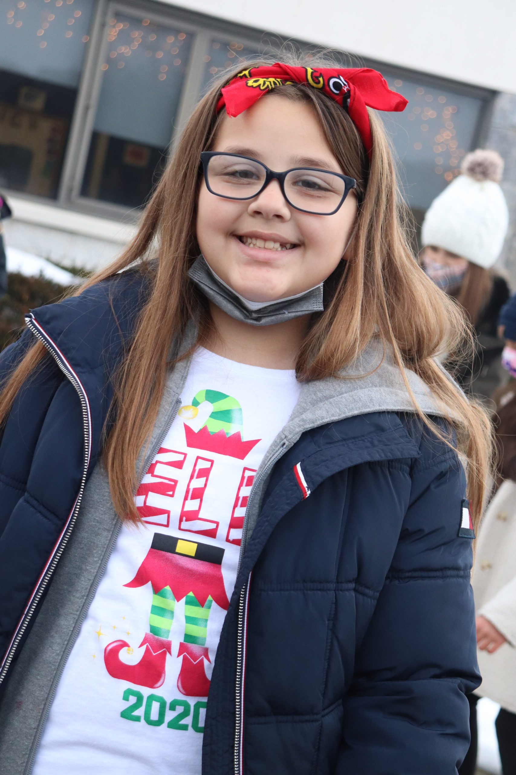 Fifth-grade student, Bella Evans, performs a series of Christmas carols during Raynor Country Day School's Salvation Army Kettle program.