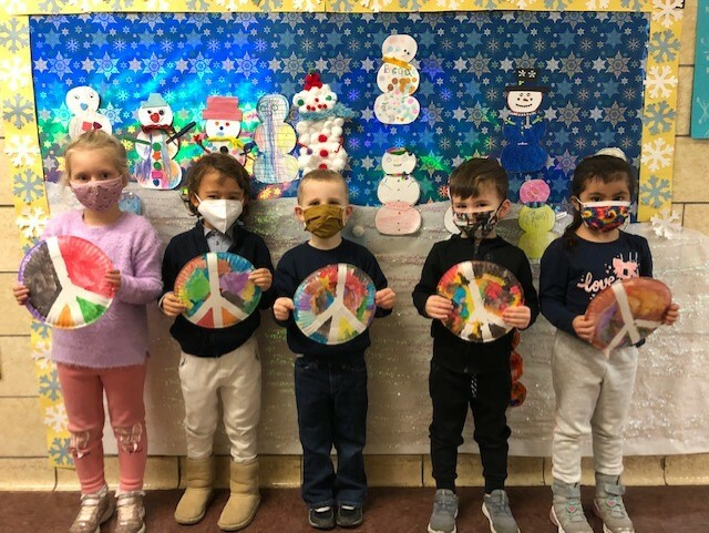 In celebrating the life of Martin Luther King Jr., the pre-kindergartners in Sam Post's class at Southampton Elementary School participated in a discussion about MLK. They also created colorful peace signs using a paper plate, tape and watercolors.