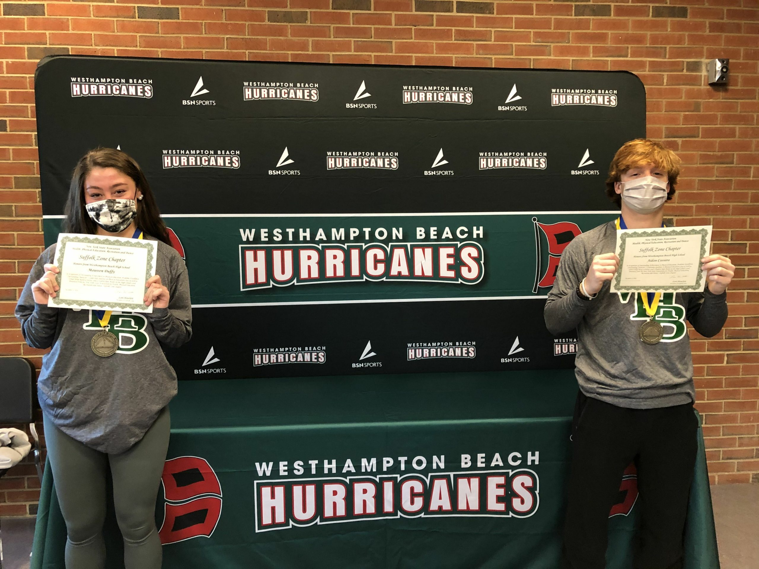 Westhampton Beach High School seniors Maureen Duffy and Aidan Cassara were honored by the New York State Association for Health, Physical Education, Recreation and Dance as winners of the Suffolk Zone Student Leadership Award. The pair were selected based on their excellence in physical education, leadership ability and service to the community.