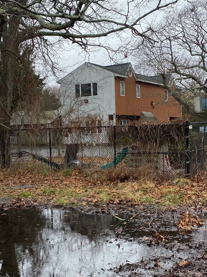 The site of the old Bel-Aire Cove Motel in Hampton Bays continues to deteriorate.