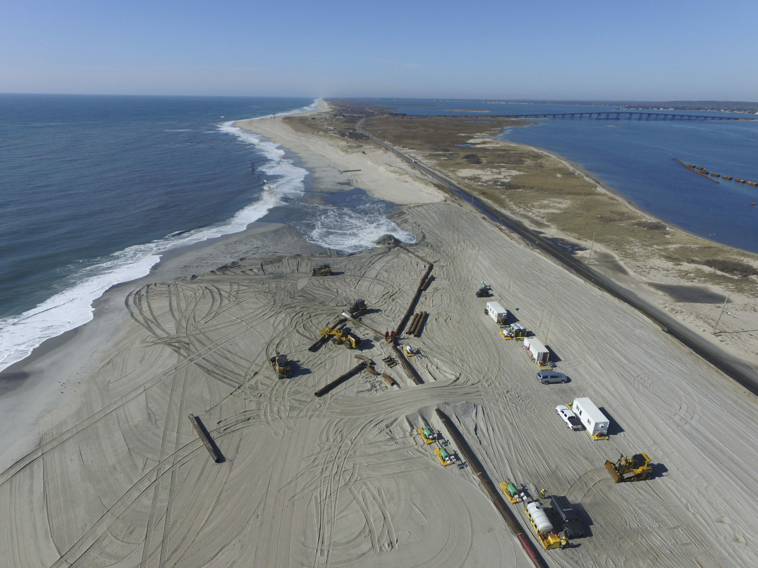 Dredging crews rebuilding the beaches west of Shinnecock Inlet in February 2020. Federal funding for massive new nourishment projects in Hampton Bays, East Quogue and Montauk was approved by Congress this month.