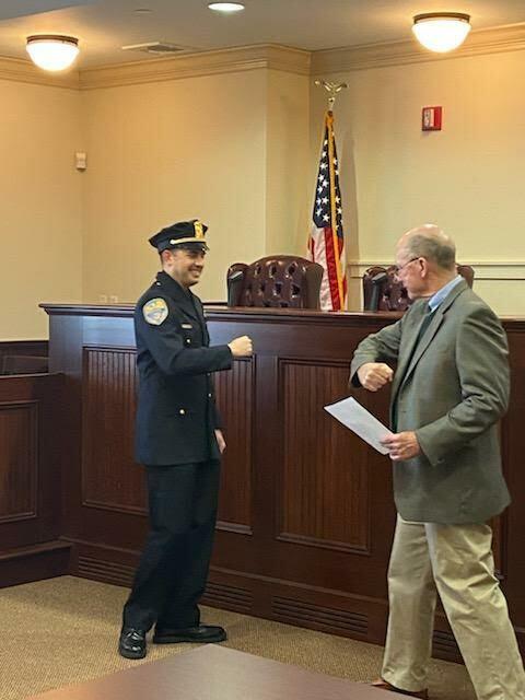 Mayor Peter Sartorius congratulates Quogue Village Police Detective William Alex Gladding on his promotion.