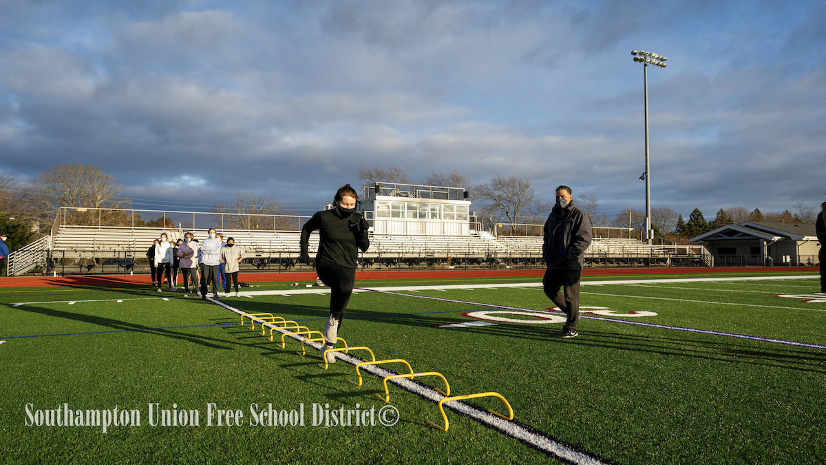 Ariana Pike goes through a drill under the watchful eye of Southampton girls track head coach Eddie Arnold.       RON ESPOSITO