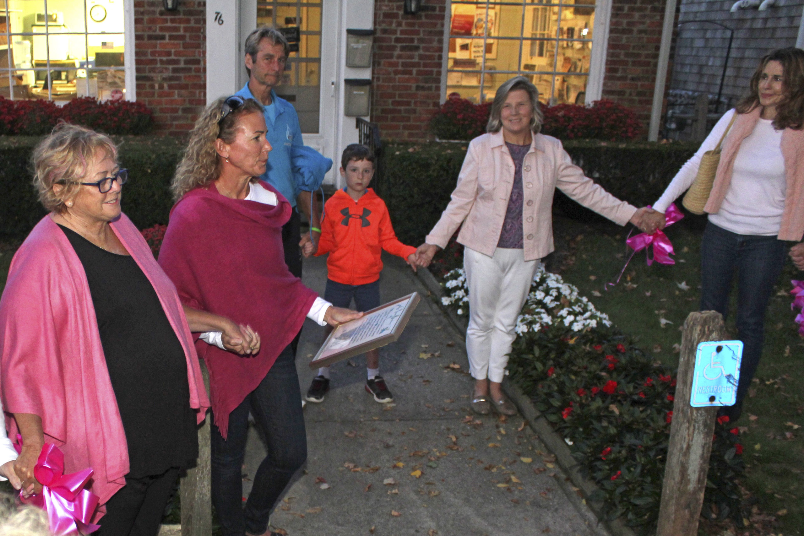 Susie Roden, far left, at the lighting of the pink tree for Breast Cancer Awareness Month in October of 2019.