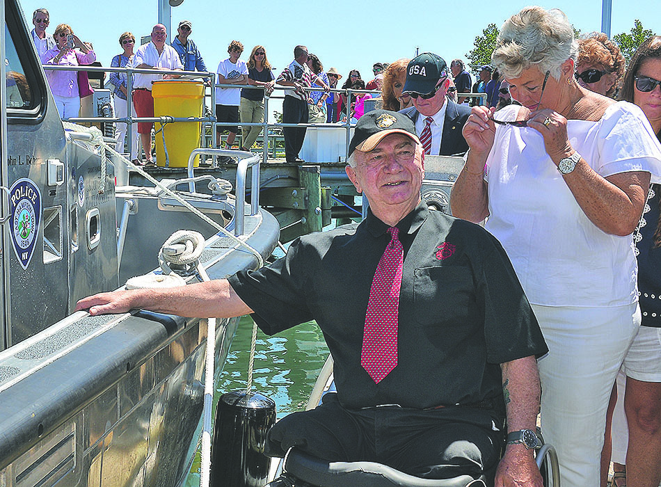John L. Behan at the christening of the East Hampton Town marine patrol vessel named in his honor in August of 2017. EXPRESS FILE