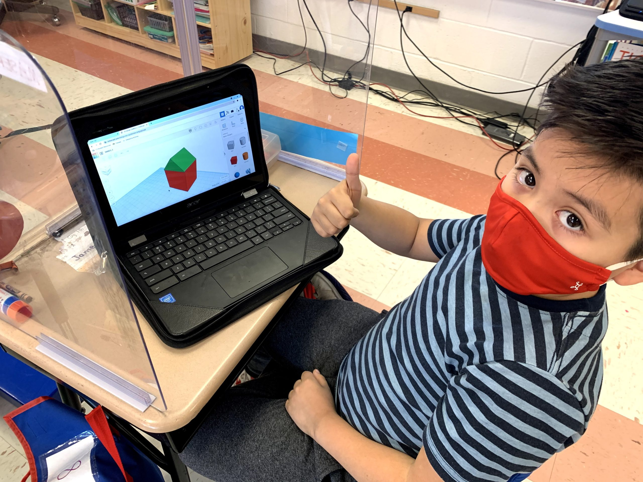 East Quogue Elementary School student James Jara — a second grader in Mrs. Masera's class — makes a house using Tinkercad as the class explores urban, suburban and rural areas and engineered their own buildings.