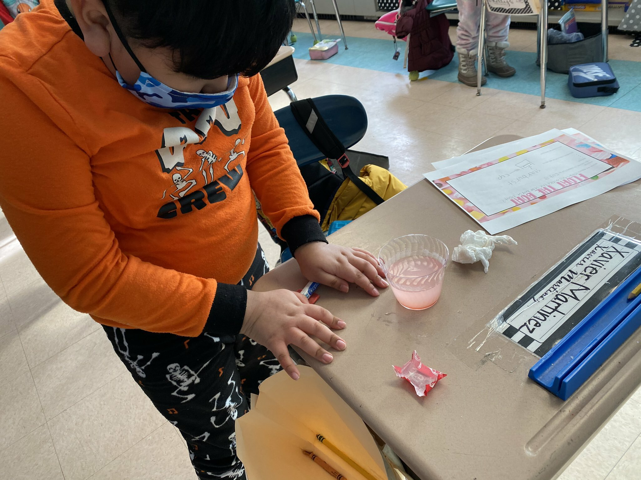 As part of a science lesson, the third graders in Claire Urizzo's class at Hampton Bays Elementary School tested the buoyancy of Starburst candies. They predicted whether the candy would sink or float and then tested their hypotheses. After the candy plunged to the bottom of their cups, they made manipulations to make it float.