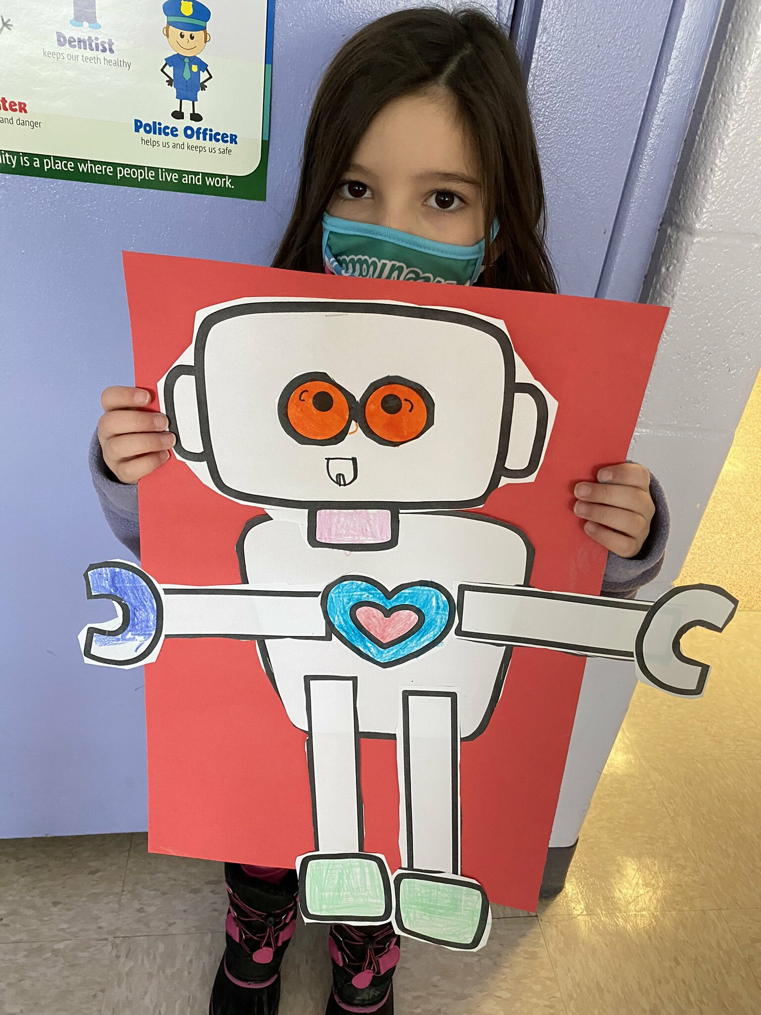 """Morgan Tiska's kindergarten class at Hampton Bays Elementary School designed """"love bots"""" as part of a Valentine's Day activity. Each student received a variety of paper cutouts that they colored and assembled together to make a unique and creative robot."""