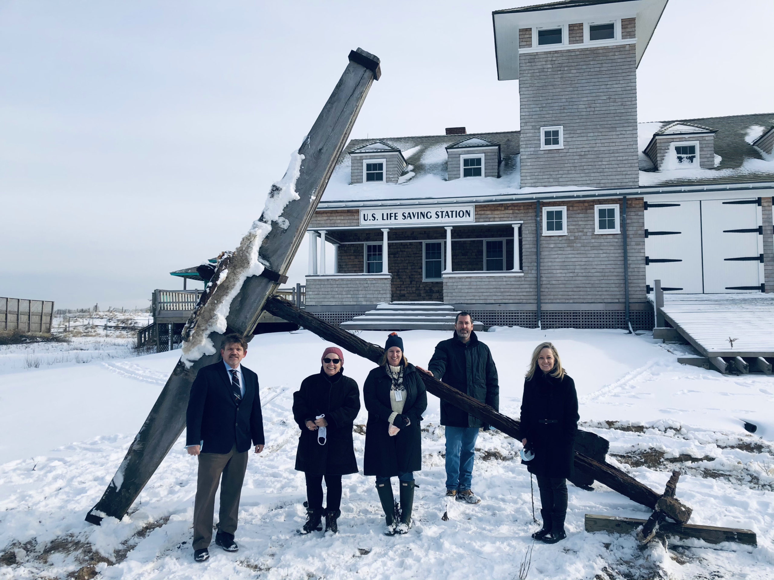 Greeting the arrival of the Circassian's anchor at the Tiana Life-Saving Station were, from left, Southampton Town Councilman Tommy John Schiavoni, CPF manager Lisa Kombrink, town historian Julie Greene, Matt Jedlicka of McLean Associates, and Town Clerk Sundy Schermeeyer.