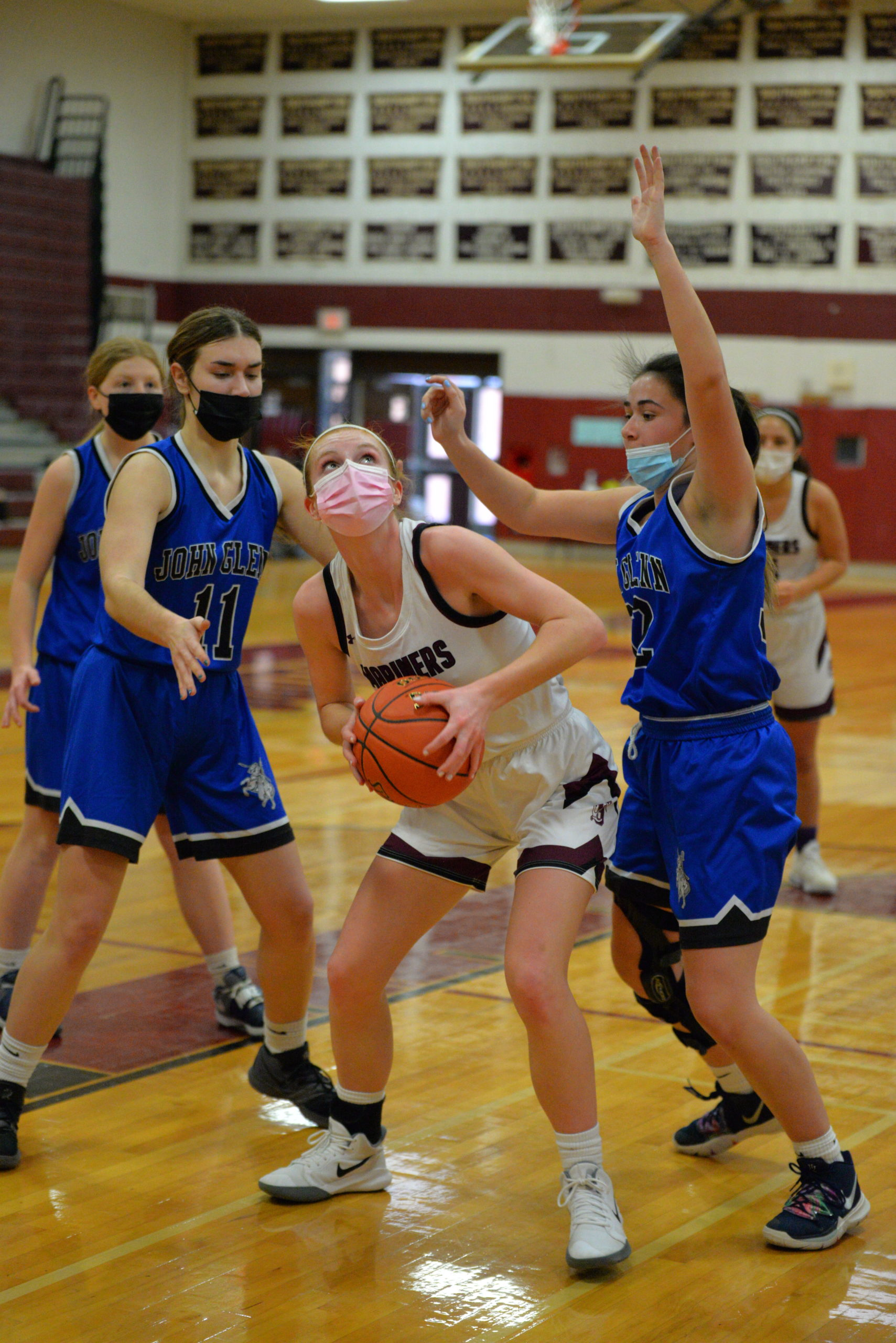 Lady Mariner Carly Cameron looks to go up for two points against Elwood/John Glenn defenders.