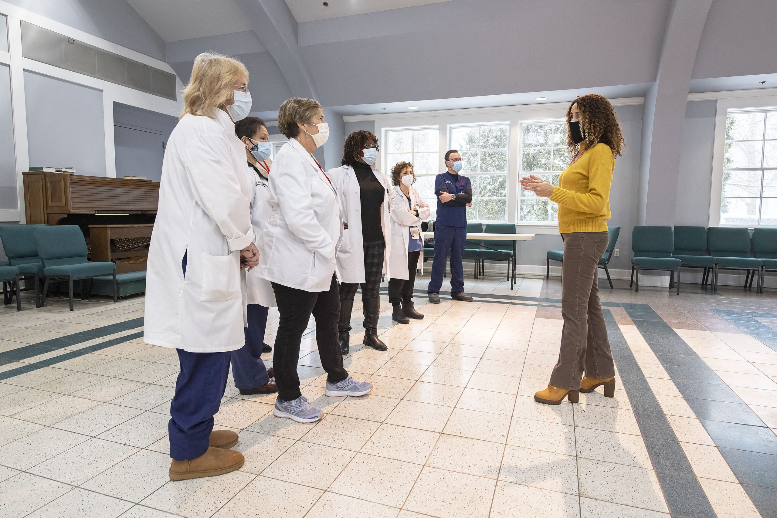 OLA  (Organización Latino-Americana) Executive Director Minerva Perez consults with Stony Brook Hospital nursing staff prior to the opening of a COVID-19 vaccine POD (Pop Up Dispensary) in the Ryan Dempsey Parrish Hall of the Most Holy Trinity Church in East Hampton on Friday.       MICHAEL HELLER