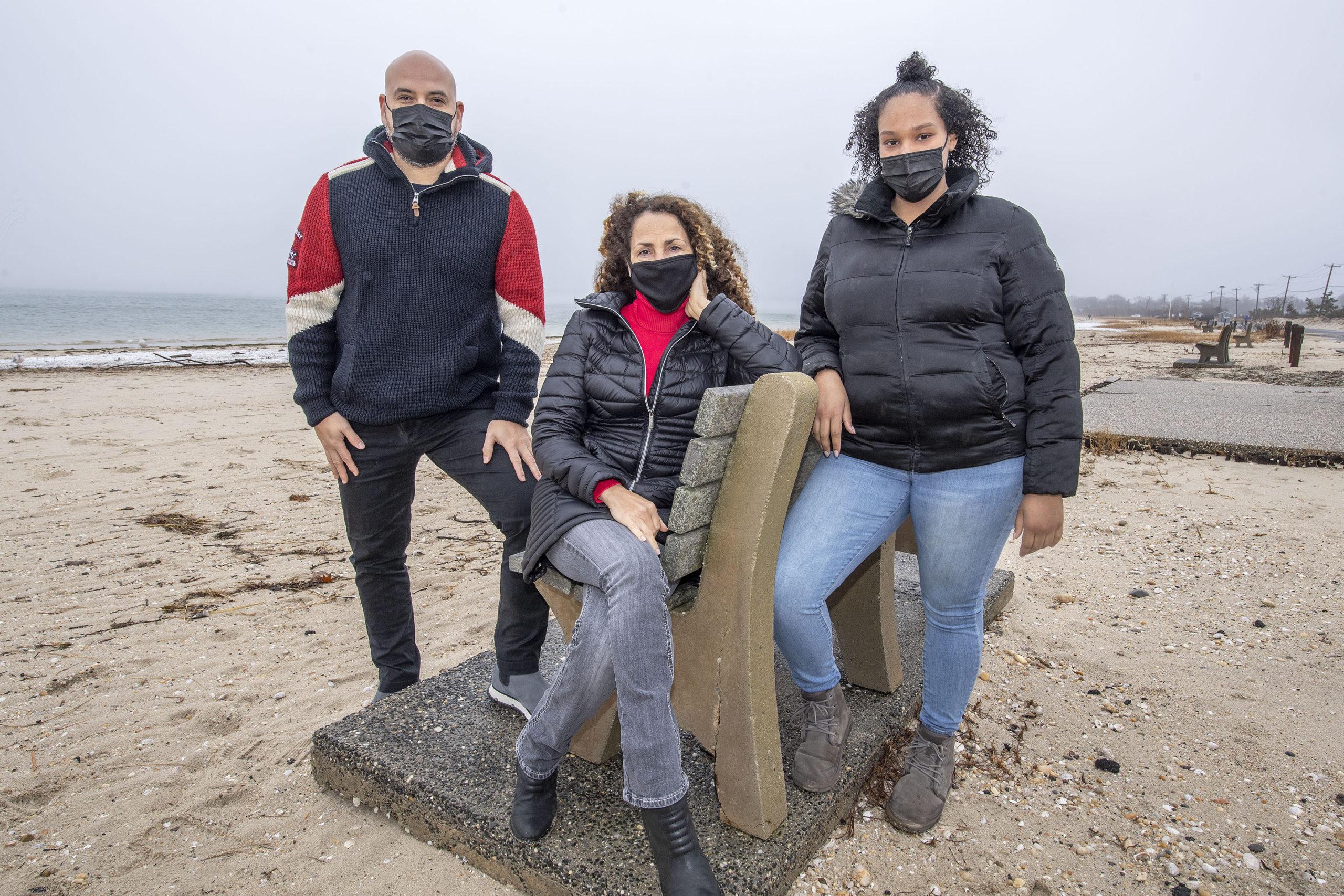 Andres Espinosa, Minerva Perez and Anna Cuffe of OLA's Project Hope, on Long Beach inn Sag Harbor on Tuesday. MICHAEL HELLER