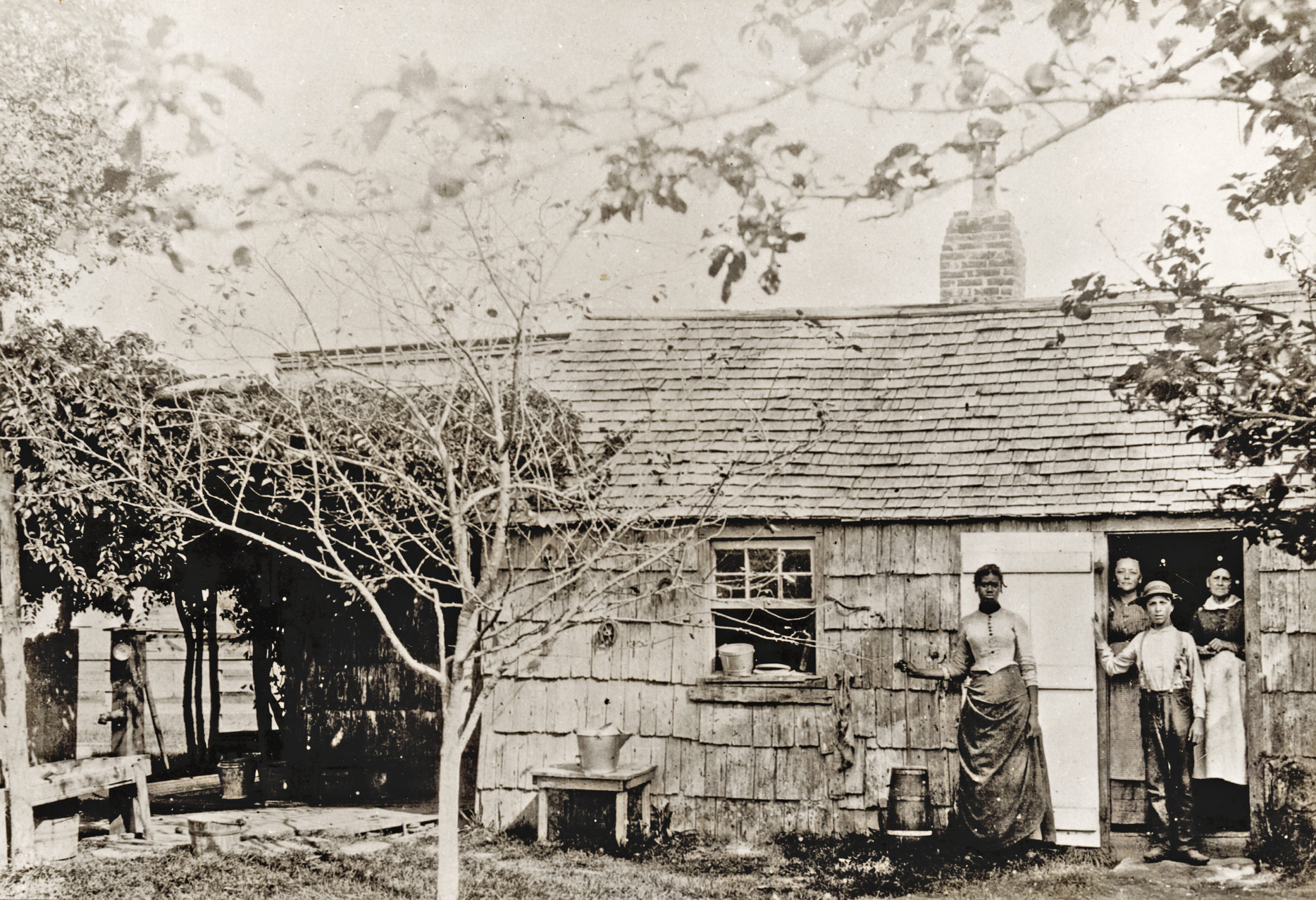 The Stratton Dayton house was in East Hampton, in the present-day Village of East Hampton. The date of this 19th century photograph and the names of the people in it are not known.   Courtesy Plain Sight Project