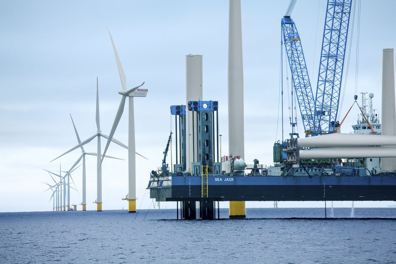 Federal regulators are reviewing proposals for how the South Fork Wind Farm should be built, including demands that its turbines be constructed away from critical fish habitat. Pictured is an Orsted wind farm being constructed off Denmark.