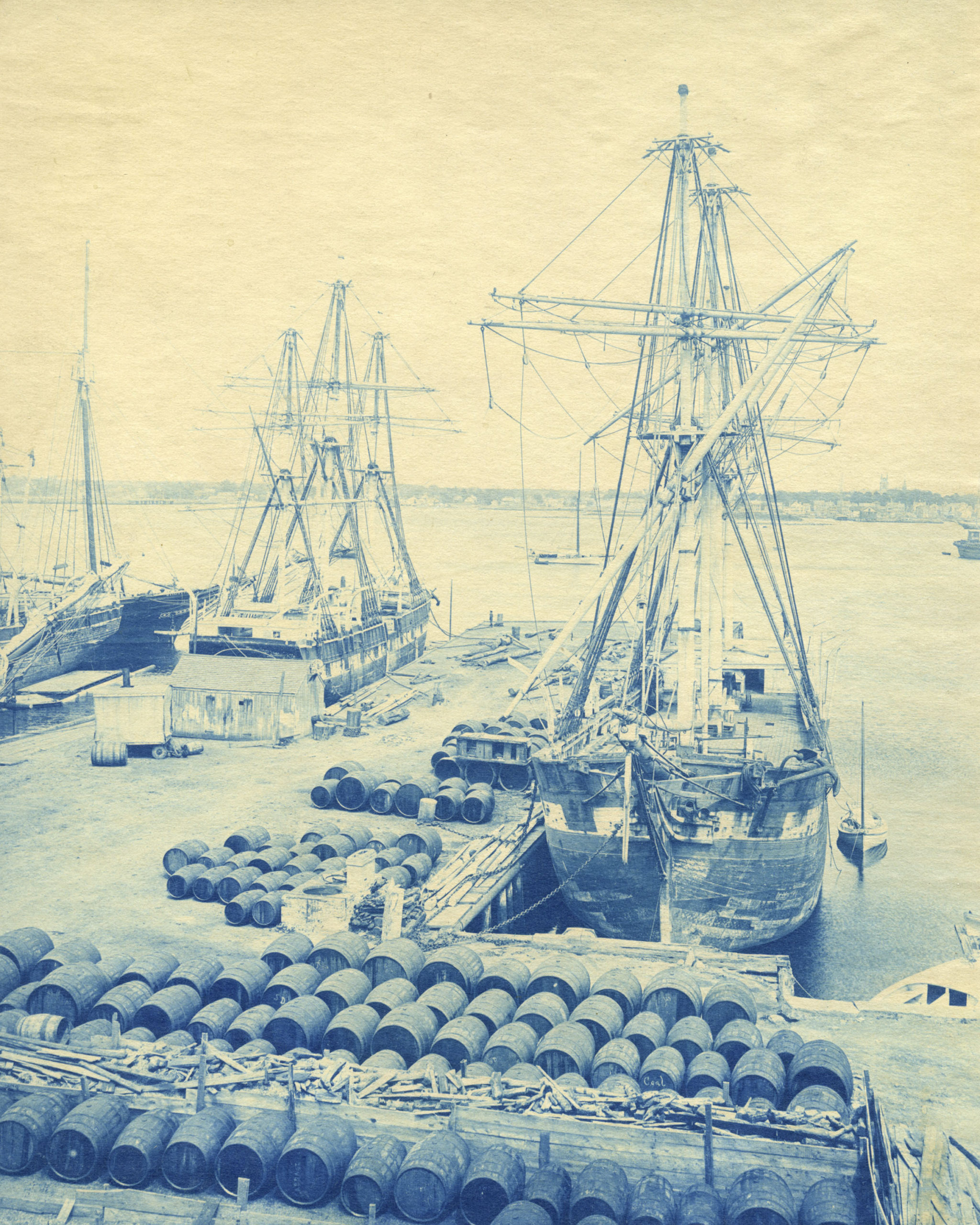 Eliza Adams at a pier in New Bedford with whaling casks in foreground.   COURTESY NEW BEDFORD WHALING MUSUEM