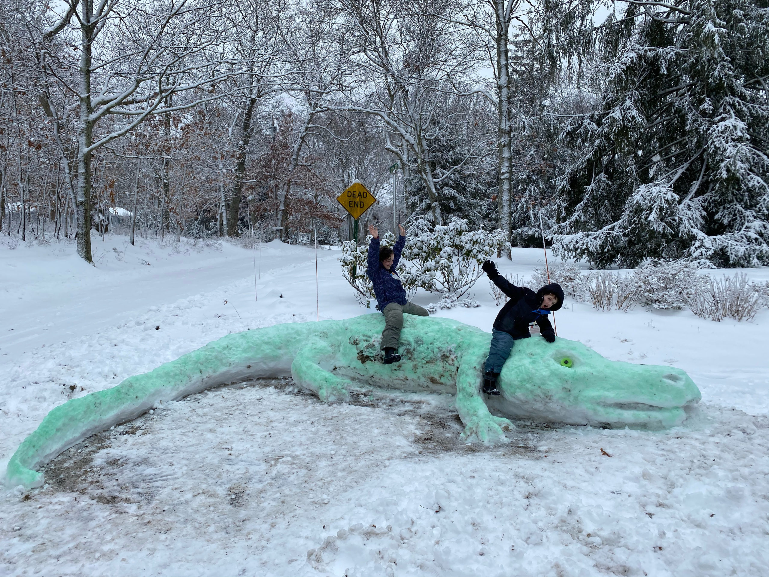 Isabella O'Leary, 9 and Desmond O'Leary, 6 of Southampton Shores with the snow alligator they created.    COURTESY MEREDITH O'LEARY