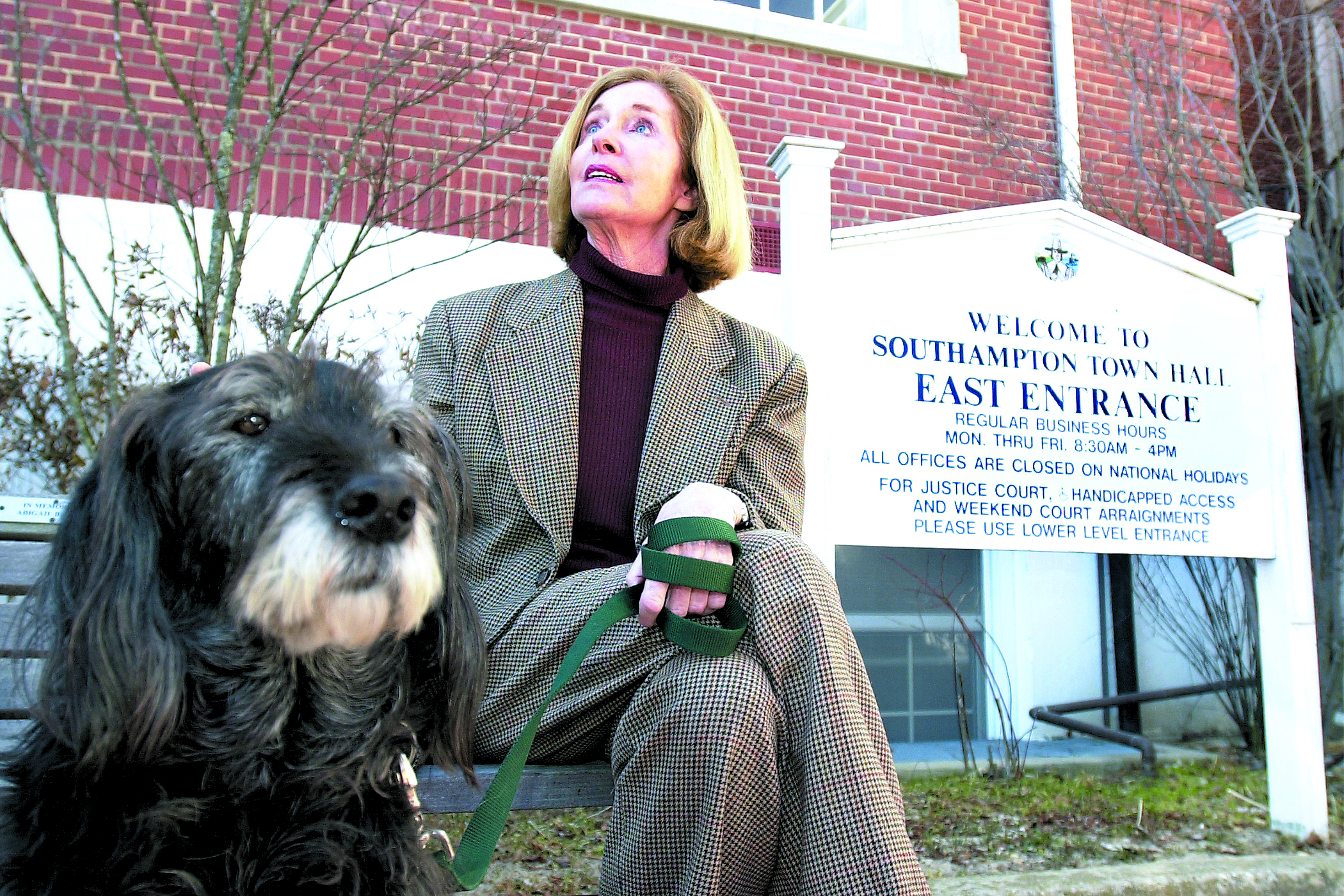 Pat Lynch with her dog, Mr. Ben, at Southampton Town Hall.   DANA SHAW