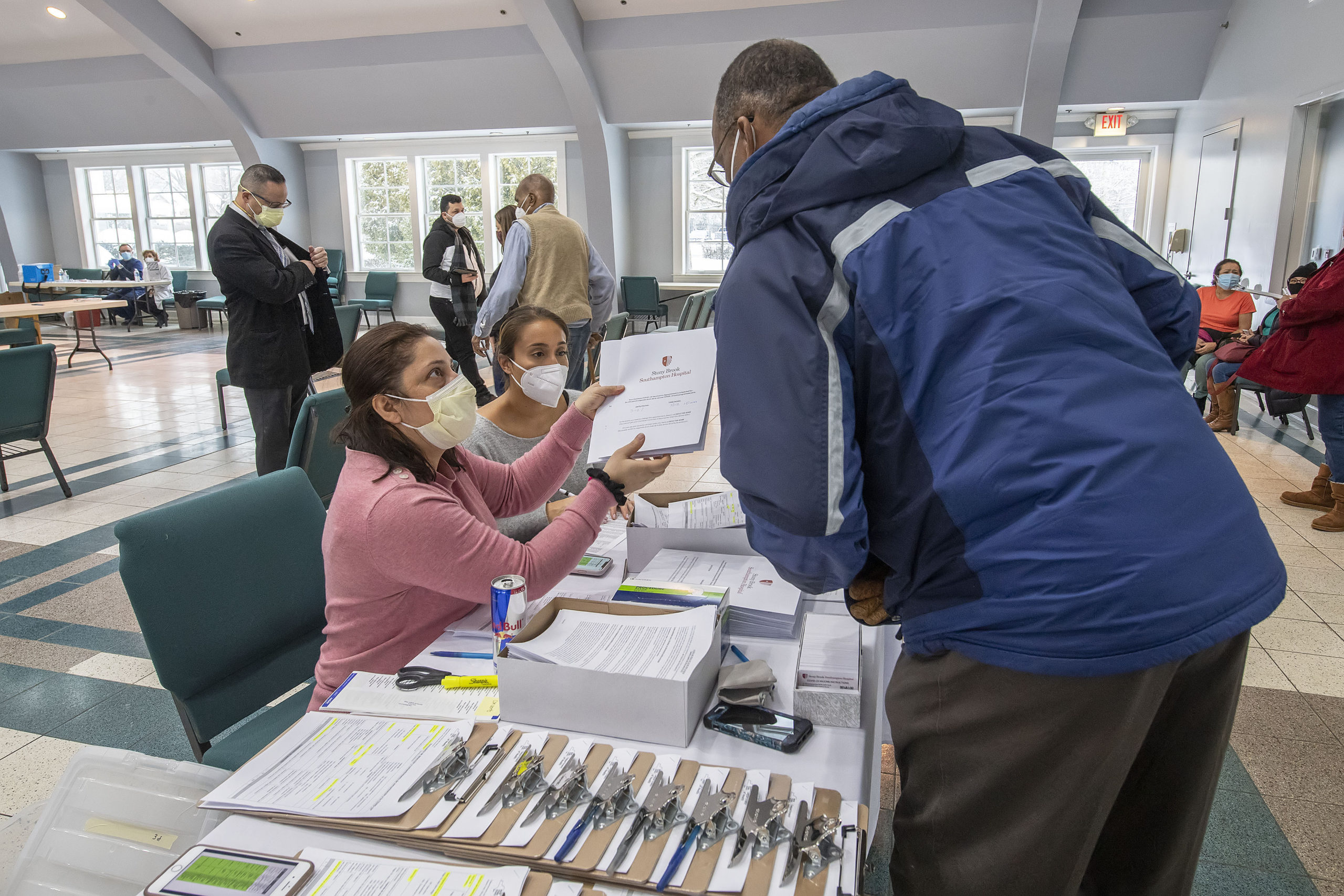 Staff helped seniors getting vaccinations in East Hampton on Friday.