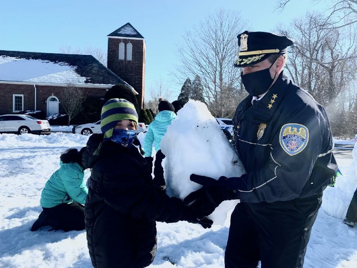 Members of the Quogue Police Department join children and staff for a day of outdoor fun at the Quogue Elementary School.