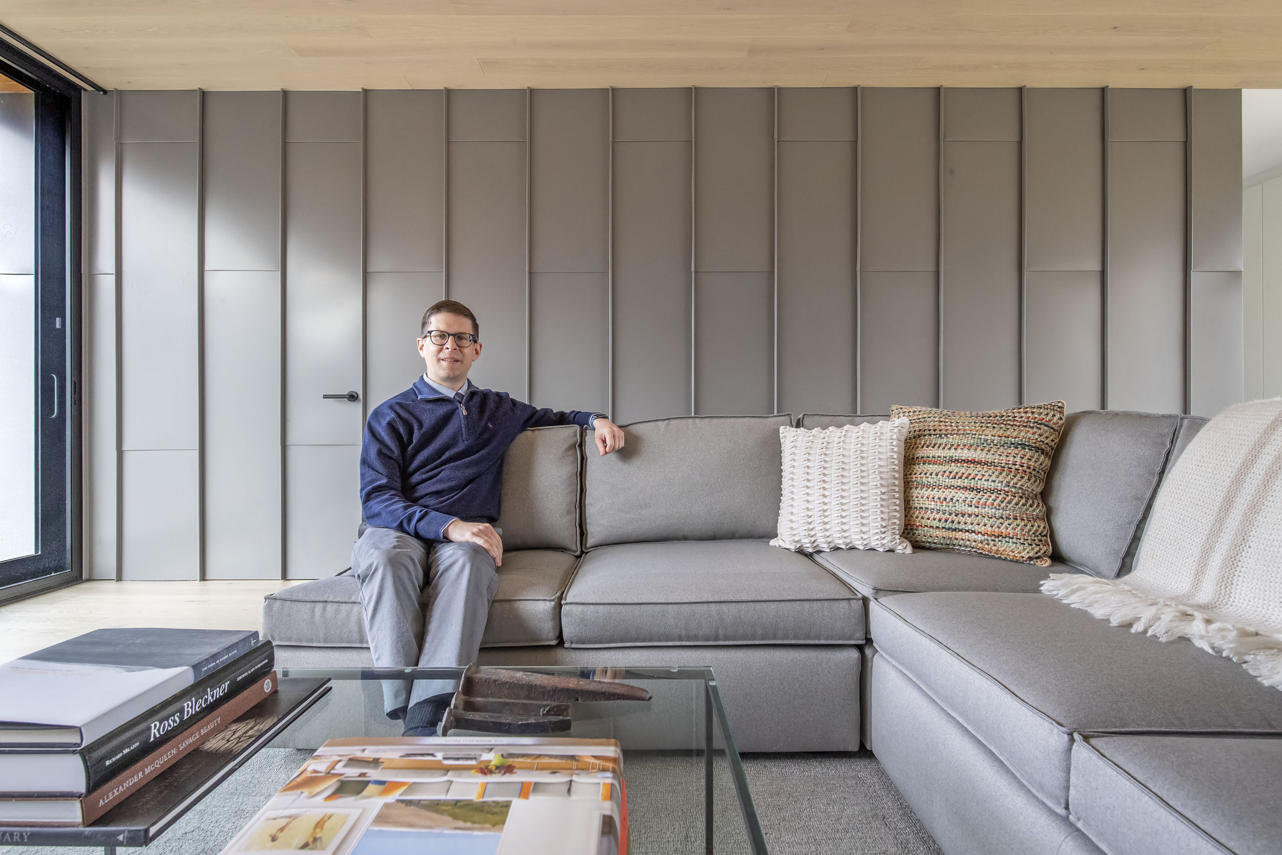 Architect Aaron Zalneraitis in the living room of the East Hampton home he designed for himself.