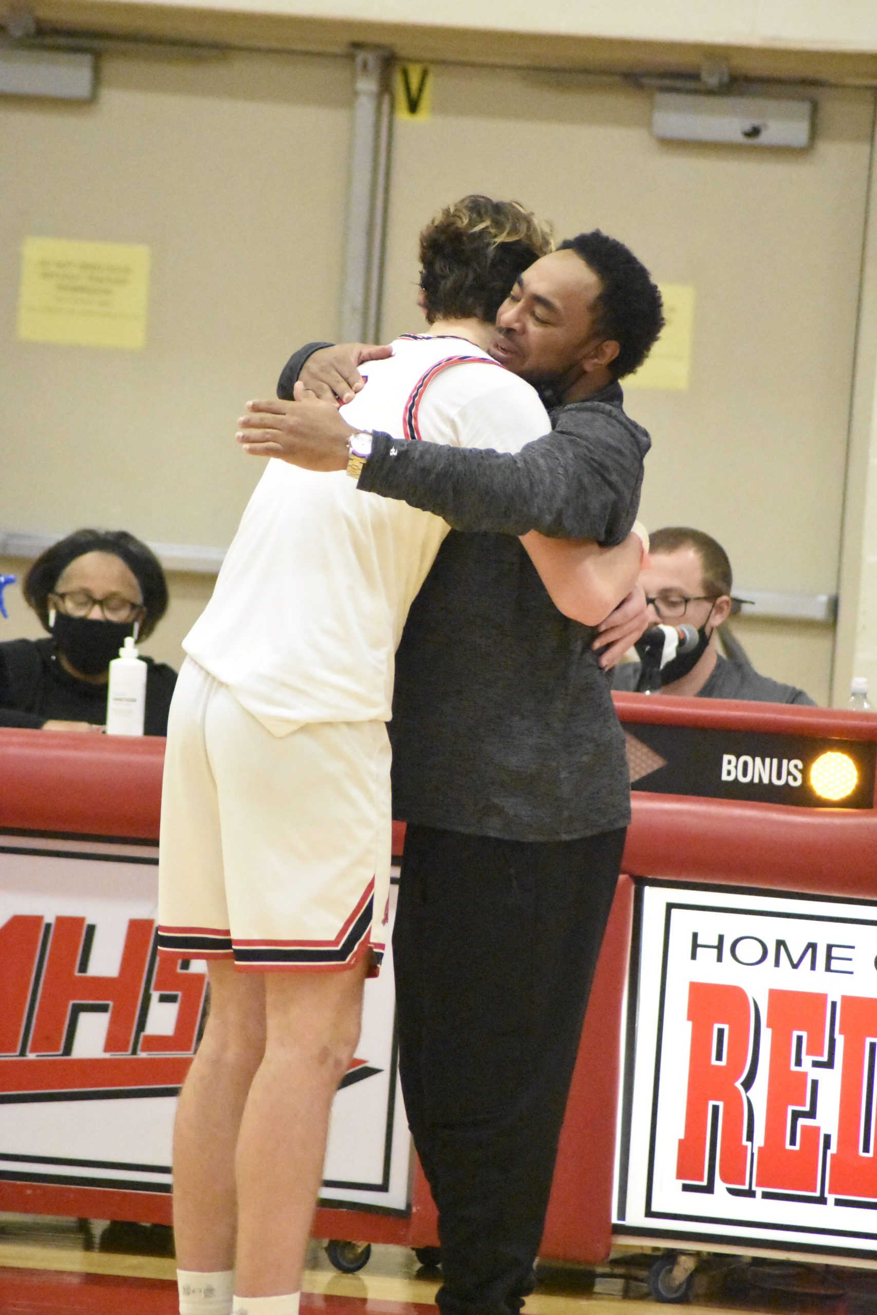 Nick Thomas and senior Jordan Falco hug each other in the waning minutes of Sunday's Conference IV Championship.
