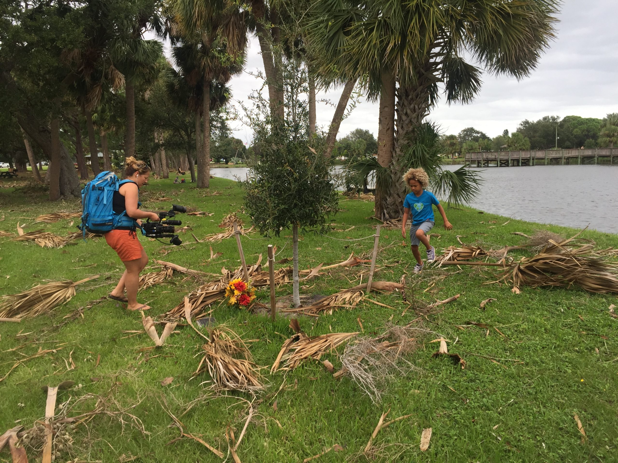 Christi Cooper filming Levi D., a plaintiff in the youth climate change case, near his Florida home after a storm.