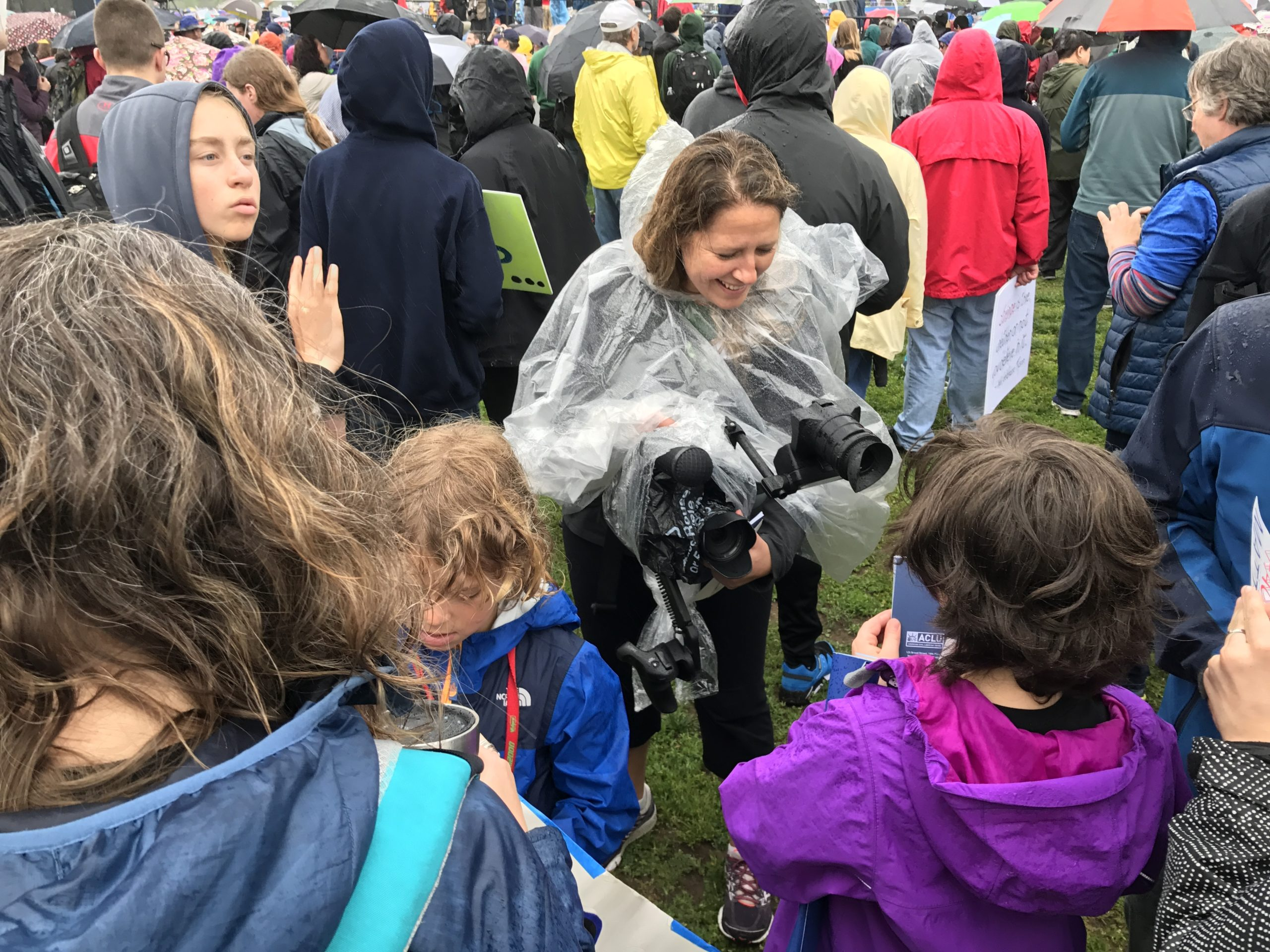 Christi Cooper filming at a science march.