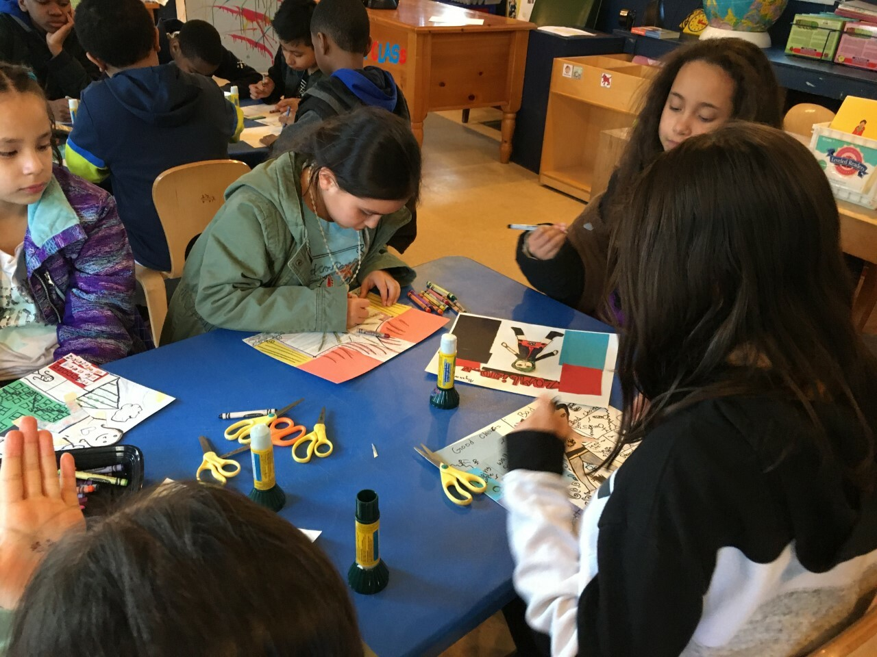 """Students work on """"The Color of Freedom"""" art show at the Bridgehampton Child Care and Recreational Center."""