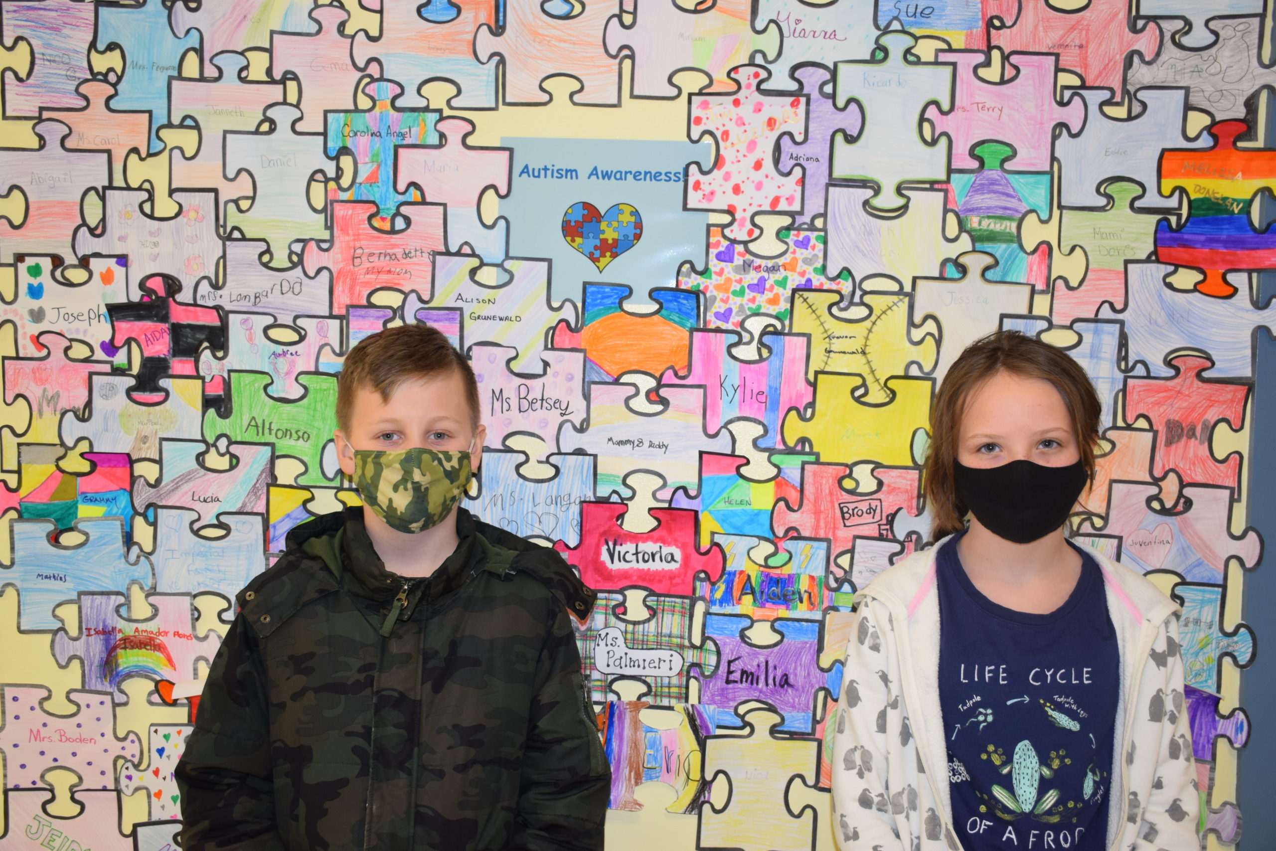 Members of Hampton Bays Elementary School's service club, K-Kids, recently raised $200 for Camp Flying Point in Southampton as part of an annual autism awareness fundraiser. The club sold paper puzzle pieces that had been colored by students and then displayed in the school's main hallway.