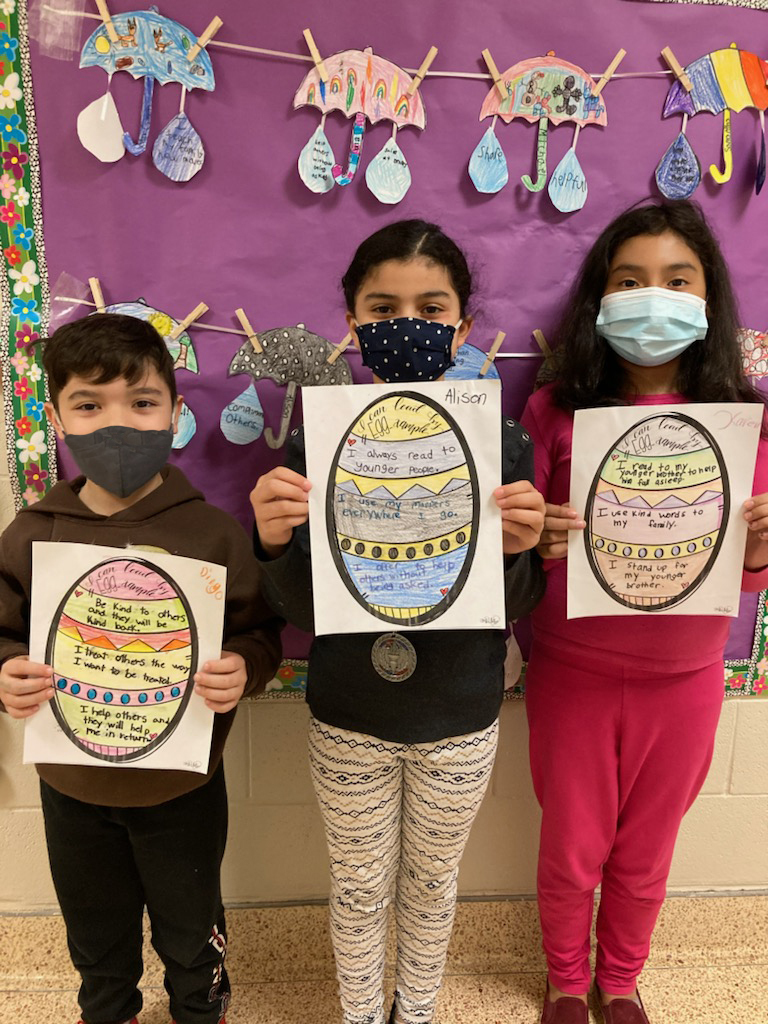 """Following a reading of """"Rechenka's Eggs,"""" a Ukrainian tale by Patricia Polacco, the third graders in Kelley Davide and Jennifer Loesch's class at Hampton Bays Elementary School created their own uniquely designed eggs that highlighted ways they could be a good """"eggs-ample"""" to their peers."""