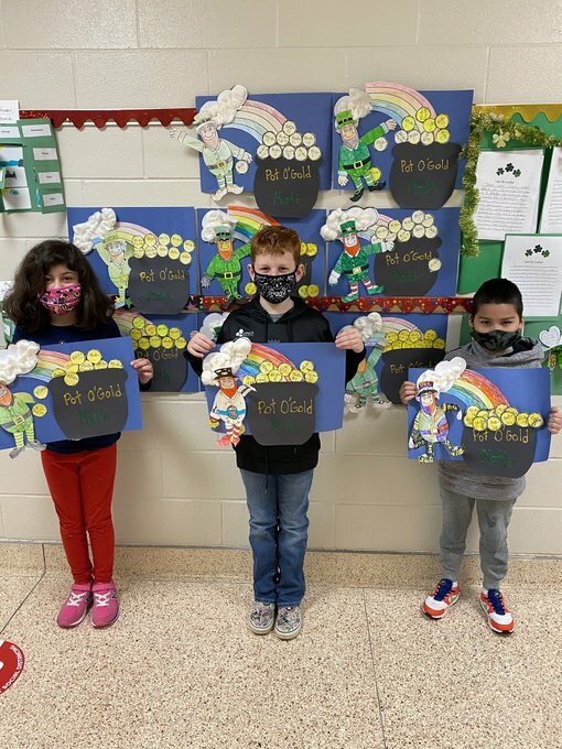 In having some St. Patrick's Day fun, Mary O'Hanlon's third graders at Hampton Bays Elementary School participated in a pot o' gold math review project. The students decorated their own pots of gold with gold coins that had multiplication and division questions they had answered. Leprechauns were added, of course, for some good luck.