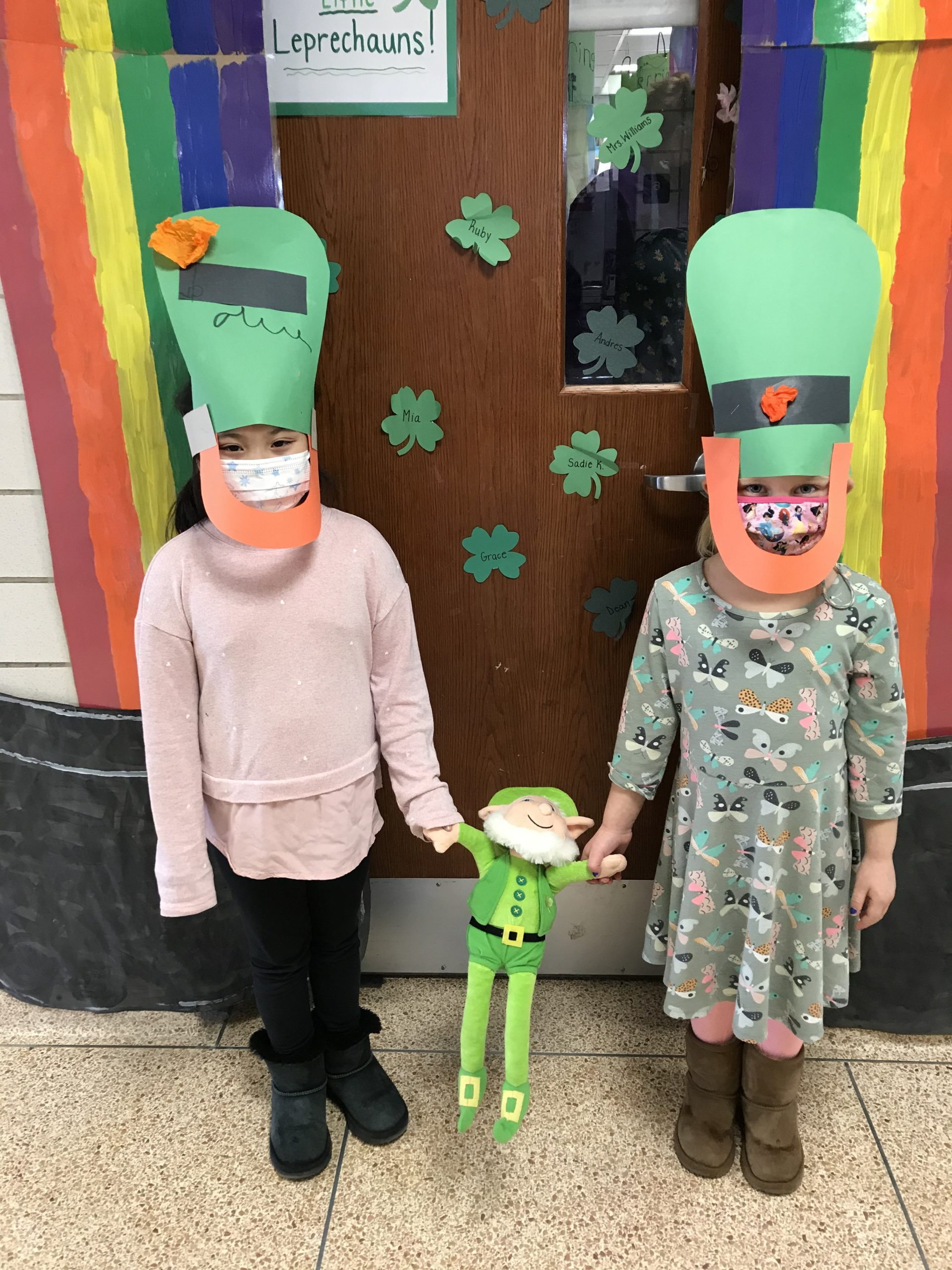 """To celebrate St. Patrick's Day, June Eaton's kindergarten class at Hampton Bays Elementary School constructed leprechaun hats, rainbows and pots of gold. They also read """"The Leprechaun's Treasure"""" and plan to build their very own leprechaun traps."""