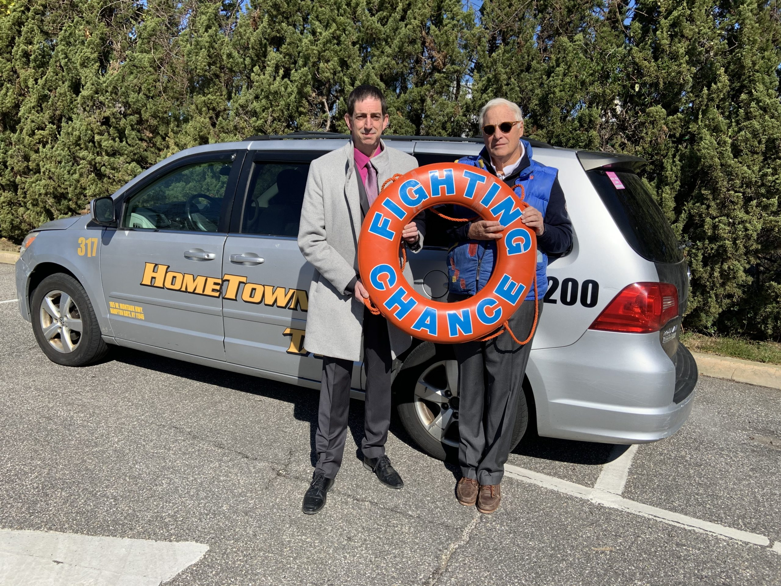 Bryan DaParma, the owner of Hometown Taxi, and Duncan Darrow, the founder of Fighting Chance, have announced a new initiative that will provide free local taxi service for cancer patients on the East End. STEPHEN J. KOTZ