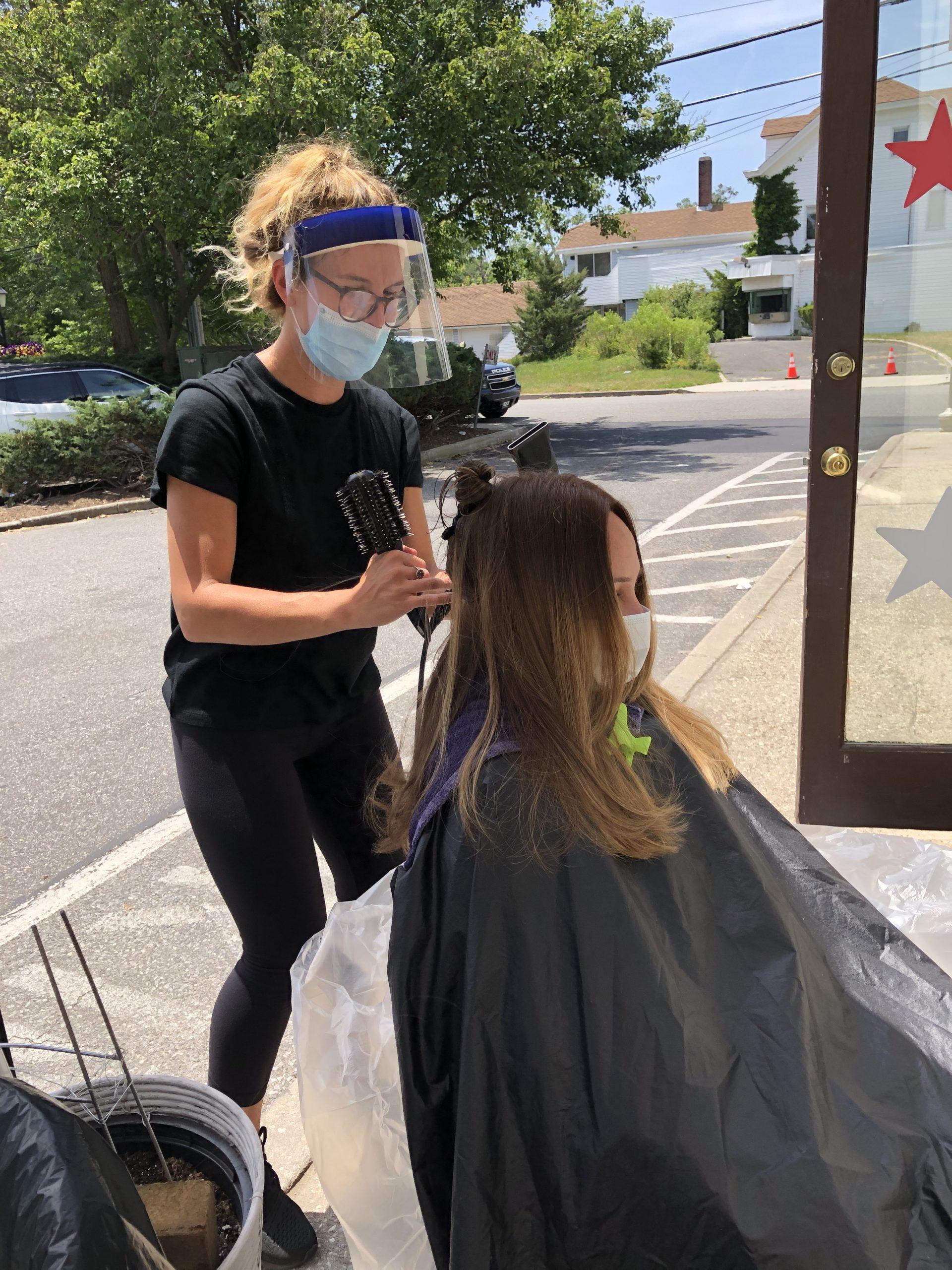 Stylist Katlyn Farrington gets creative at Lillian's Hair Salon in Westhampton Beach.