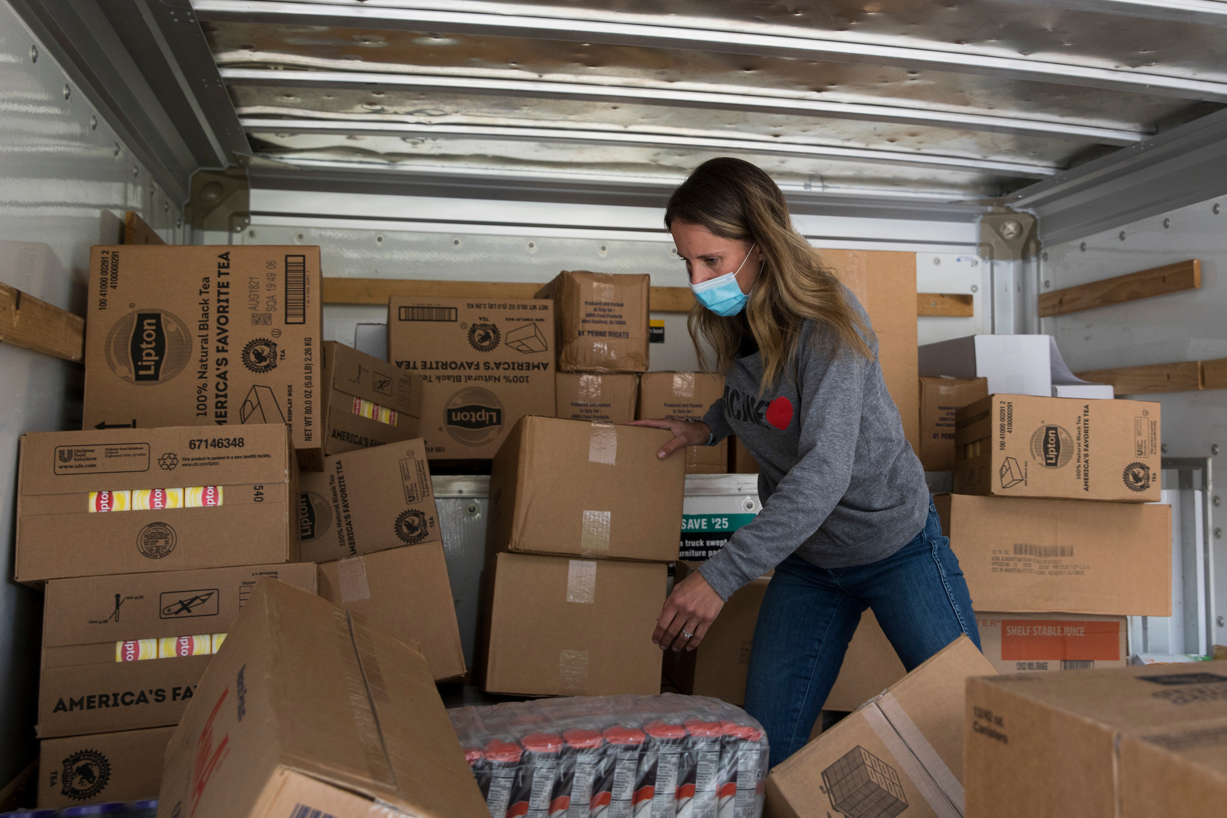 Marit Molin helps with food distribution through her organization, Hamptons Community Outreach.