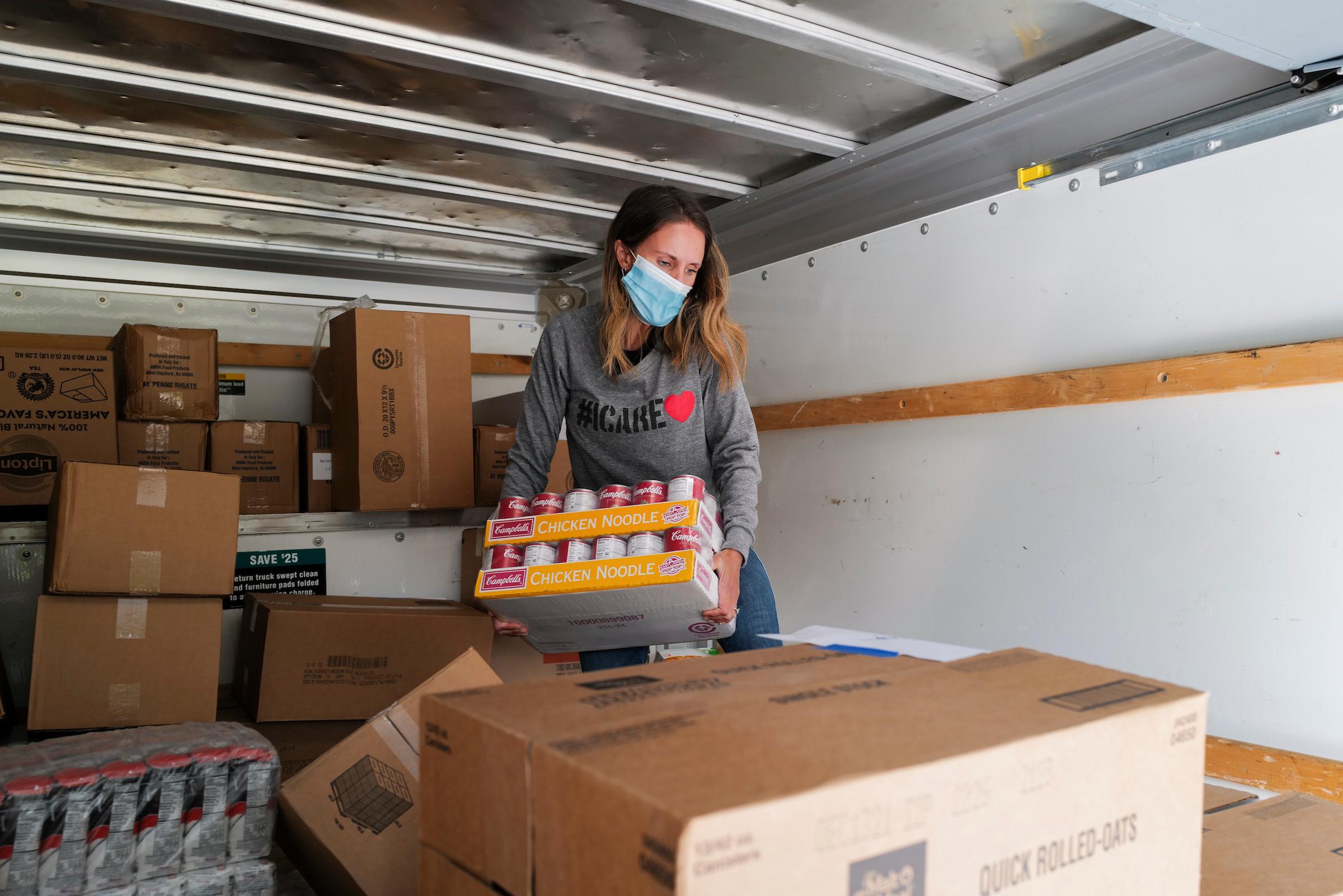 Marit Molin helps with food distribution through her organization, Hamptons Community Outreach.  LORI HAWKINS