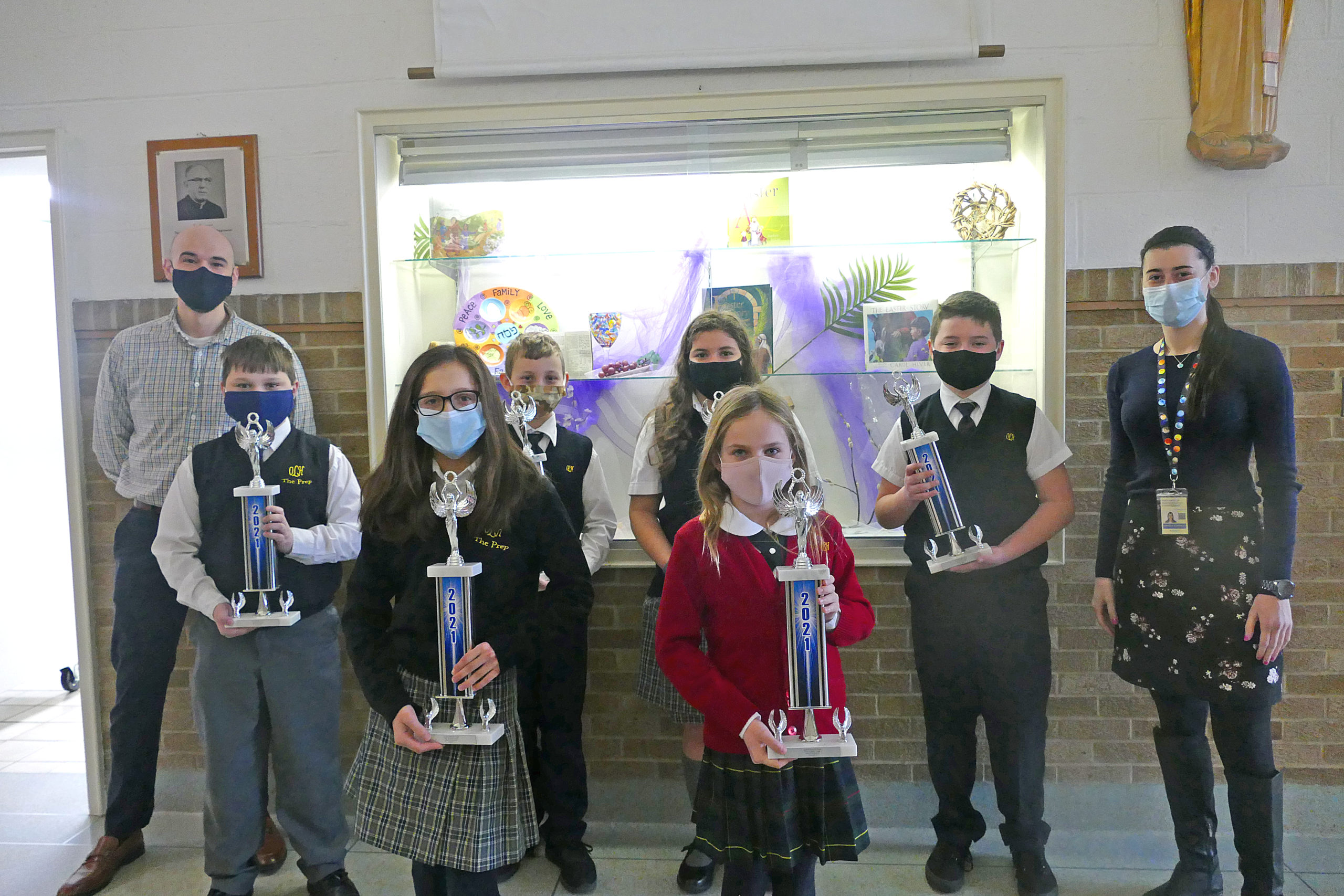 The grade level winners of the Science Shark Tank at OLH are, pictured with their teachers, Logan Robinson and Amanda Burriesci, Sofia Patrone, Bianca Alvarado, Conner McVeigh, Steven Kellis, Joseph Martin and Addison Cinelli.  COURTESY OUR LADY OF THE HAMPTONS