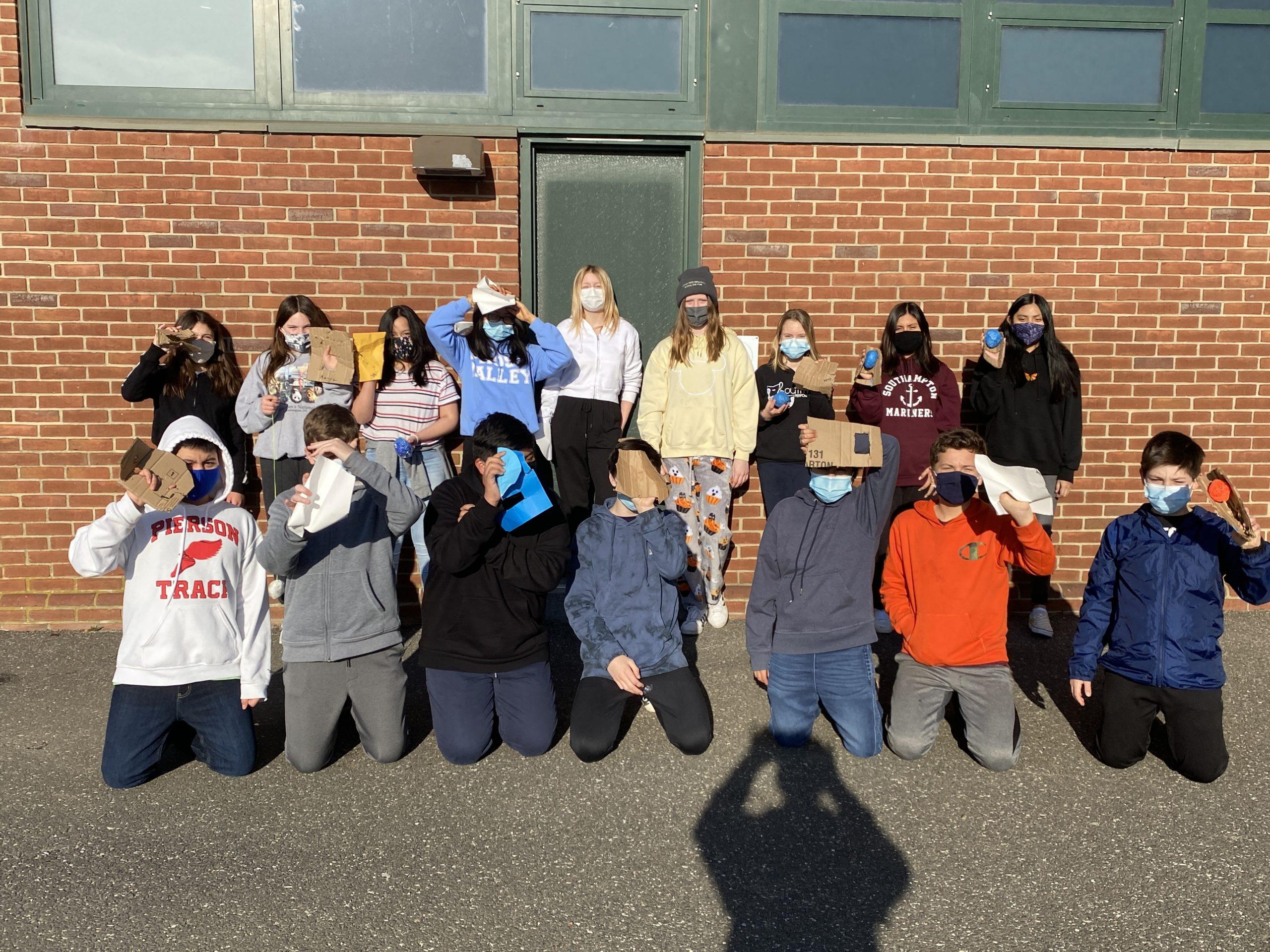 Southampton Intermediate School students designed baseball gloves using cardboard as part of a study on the life of Felipe Alou.
