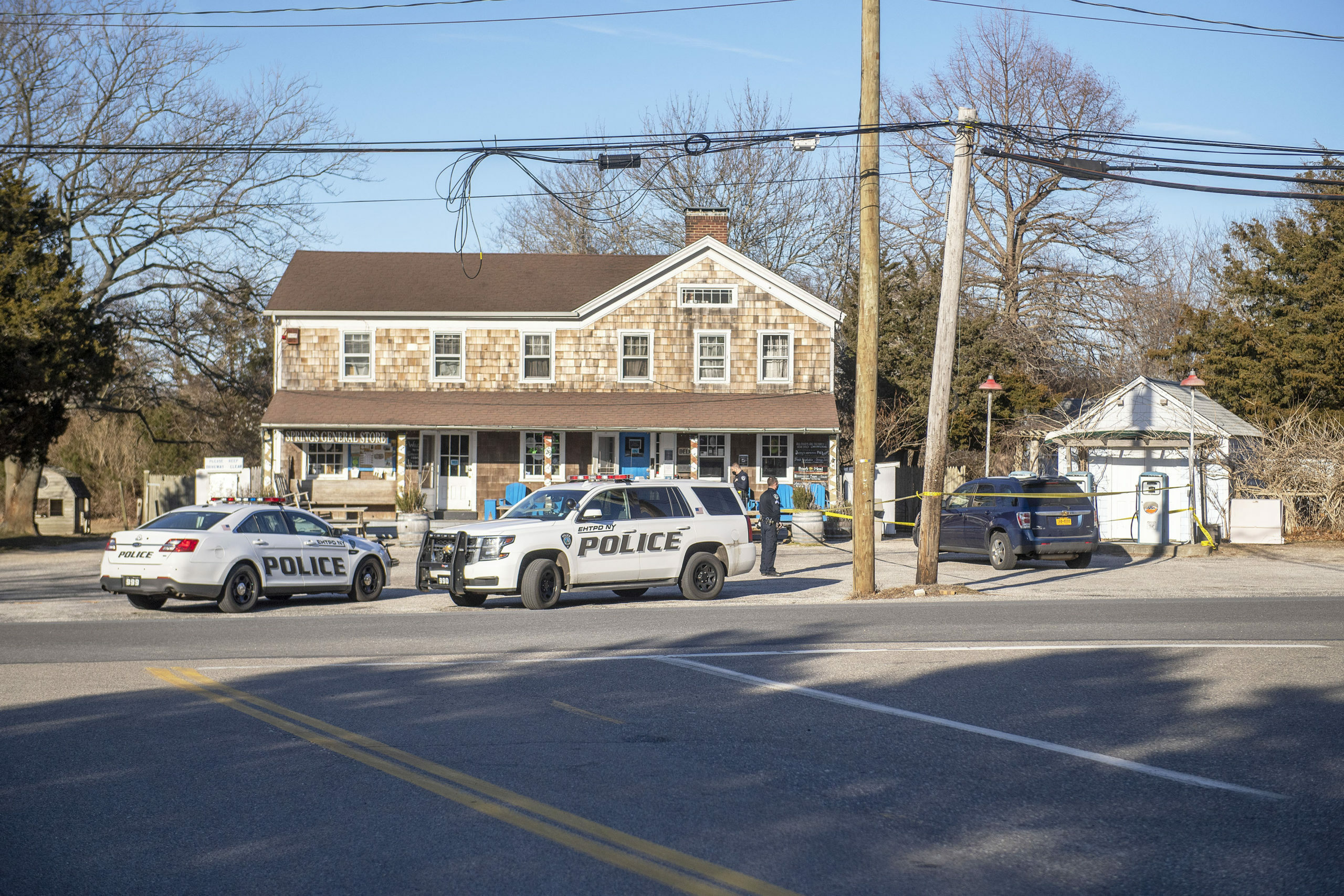 Police at the Springs General Store where the woman who was robbed on March 8 reported the crime. A 47-year-old Springs man was arrested on Monday morning and is to be charged with robbery and kidnapping in connection with the incident. His attorney says it is a case of mistaken identity.