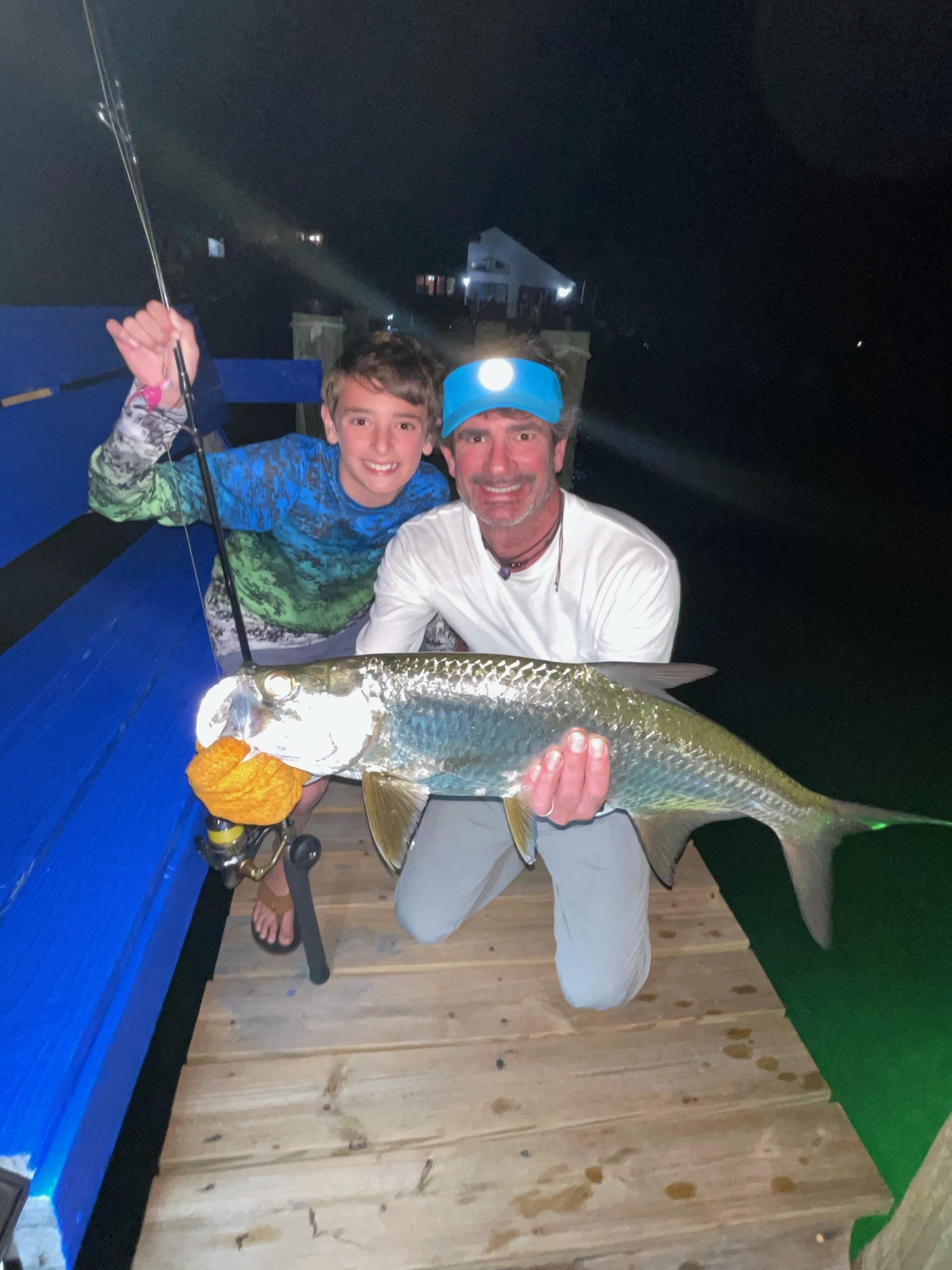 Joe and Taylor Baratta with a Florida Keys tarpon they caught from shore while on vacation last month.