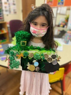 """Our Lady of the Hamptons pre-kindergarten student Carina Gerardi shares her """"leprechaun catcher,"""" one of the many activities the regional Catholic school in Southampton enjoyed in advance of celebrating St. Patrick's Day."""