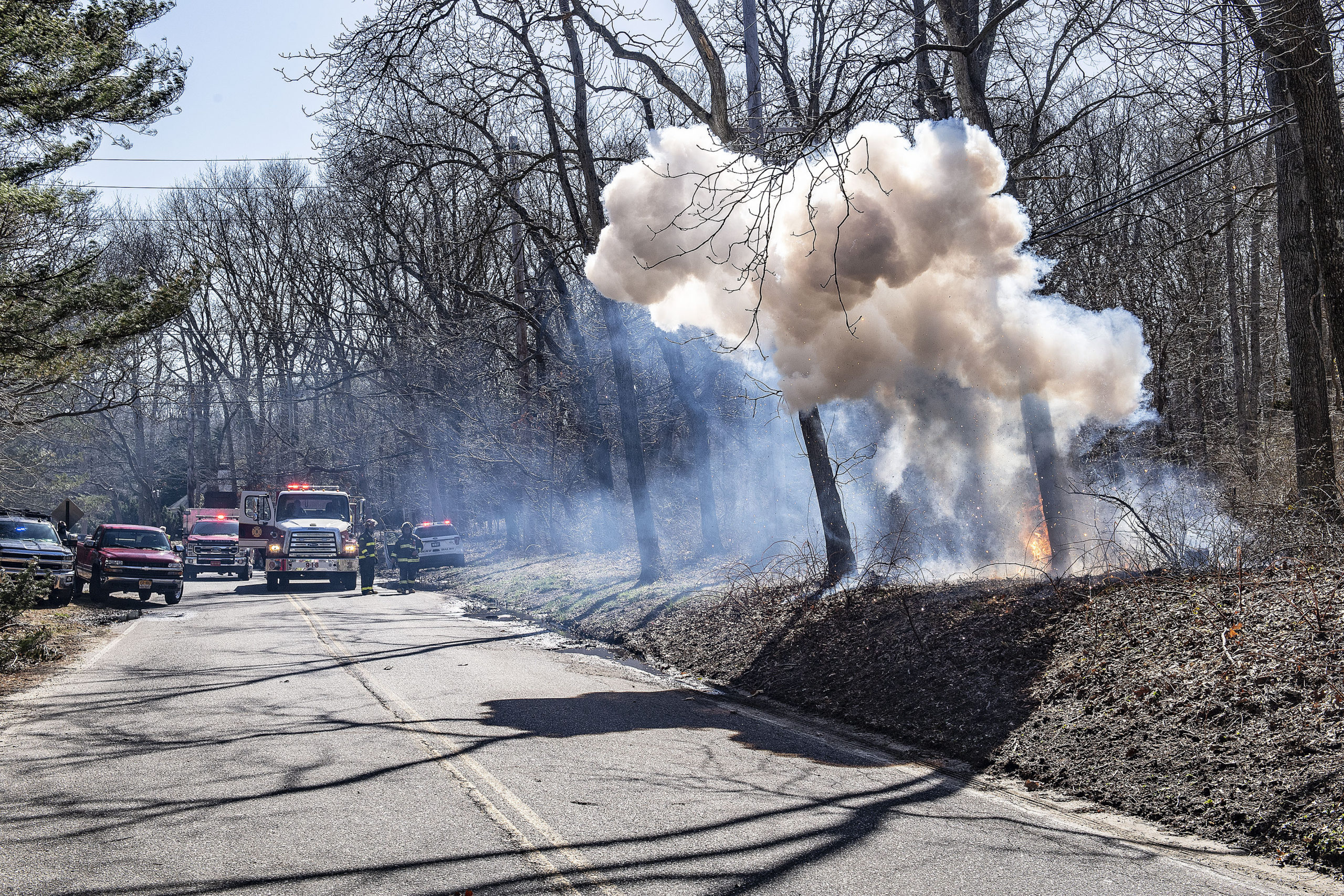 The East Hampton Fire Department stood by on Monday to make sure a brush fire started by downed power lines on Buell Lane didn't spread.