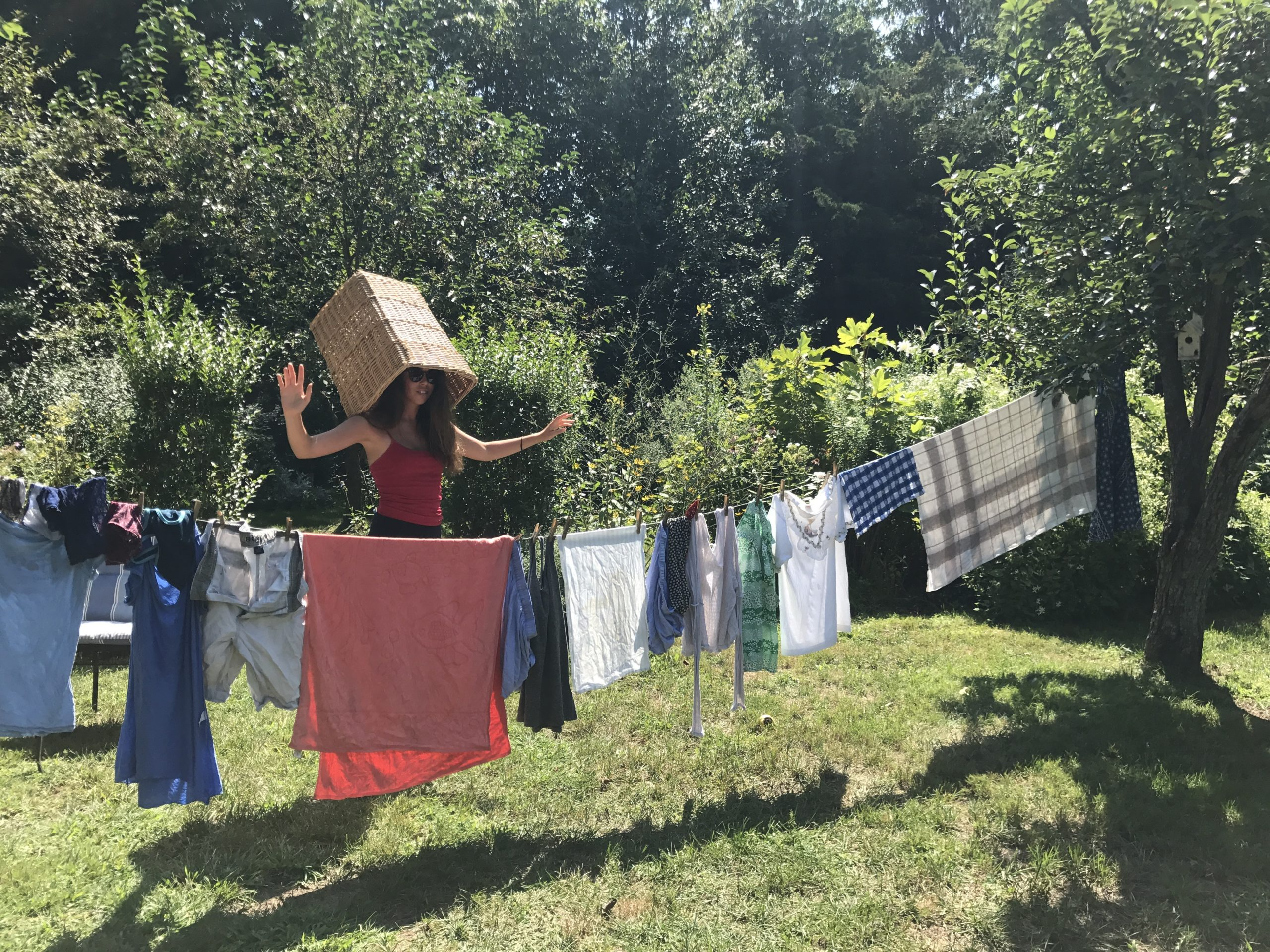 Teenager Carley Wootton demonstrates that air drying laundry tree-to-tree isn't always done efficiently.